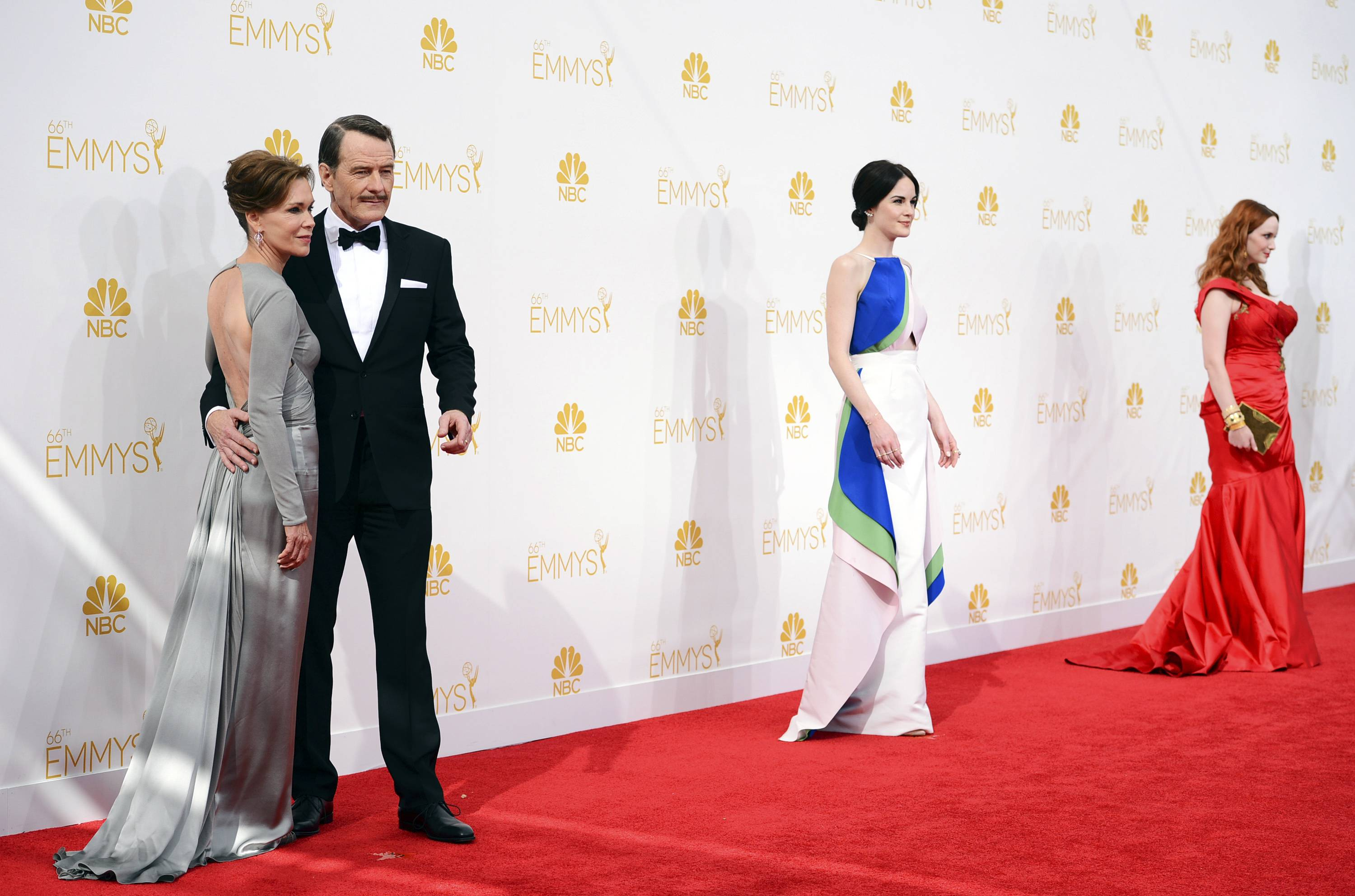 Robin Dearden, from left, Bryan Cranston, Michelle Dockery and Christina Hendricks arrive at the 66th Annual Primetime Emmy Awards at the Nokia Theatre.