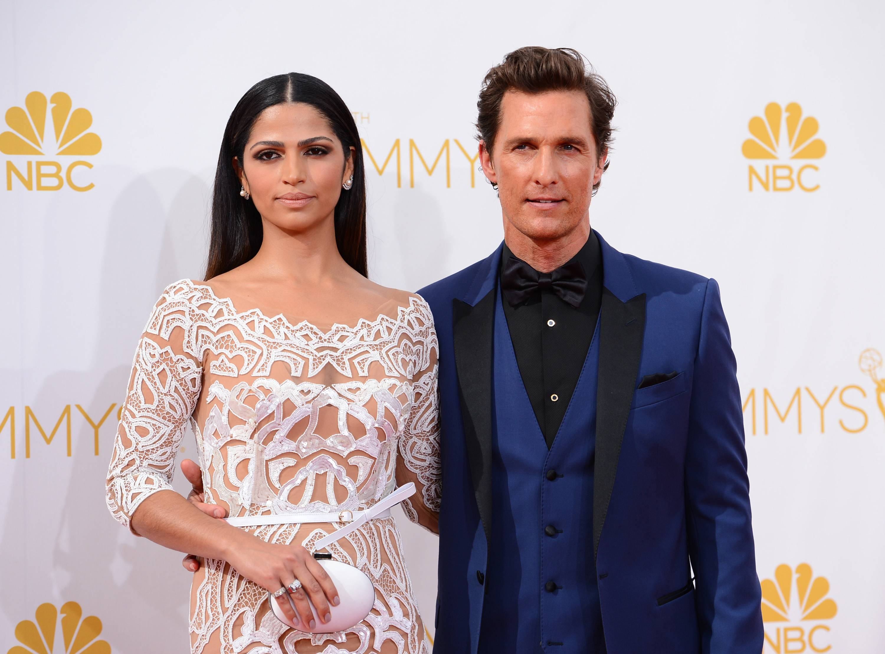 Camila Alves, left, and Matthew McConaughey arrive at the 66th Annual Primetime Emmy Awards at the Nokia Theatre.