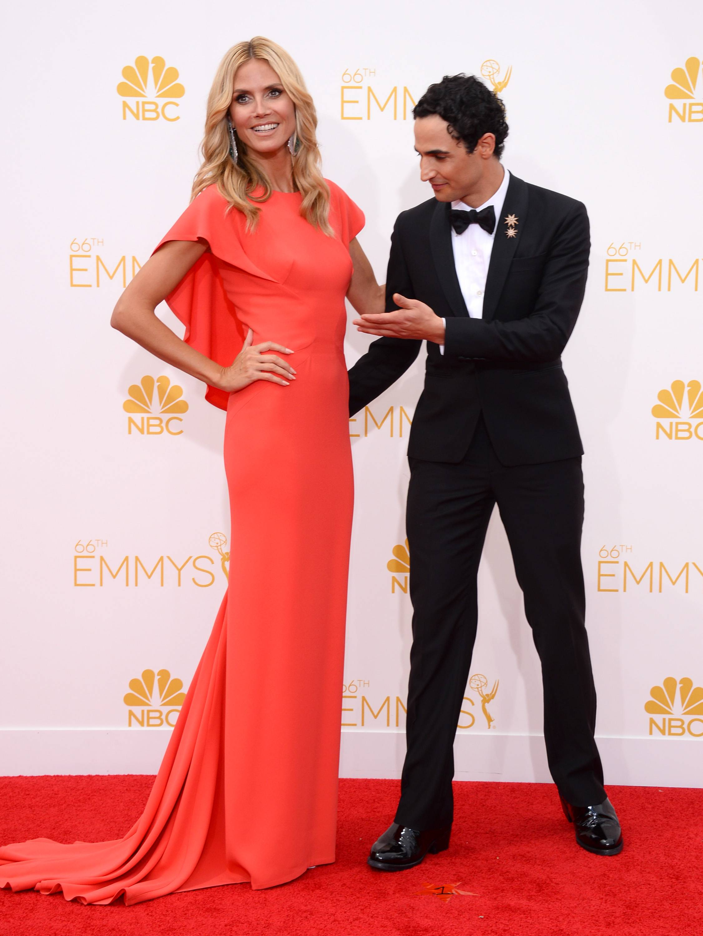 Heidi Klum, left, and Zac Posen arrive at the 66th Annual Primetime Emmy Awards.