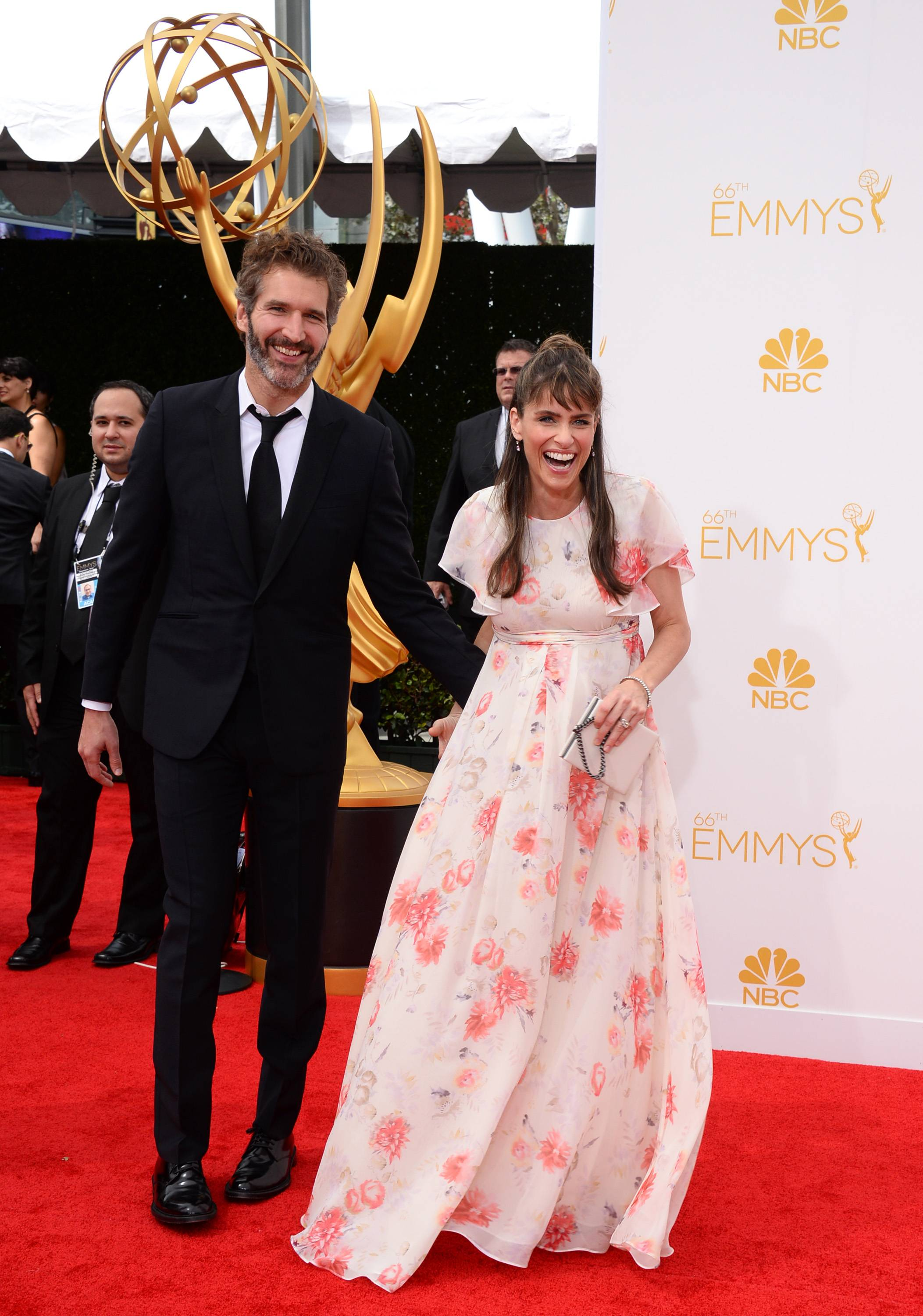 David Benioff, left, and Amanda Peet arrive at the 66th Annual Primetime Emmy Awards.
