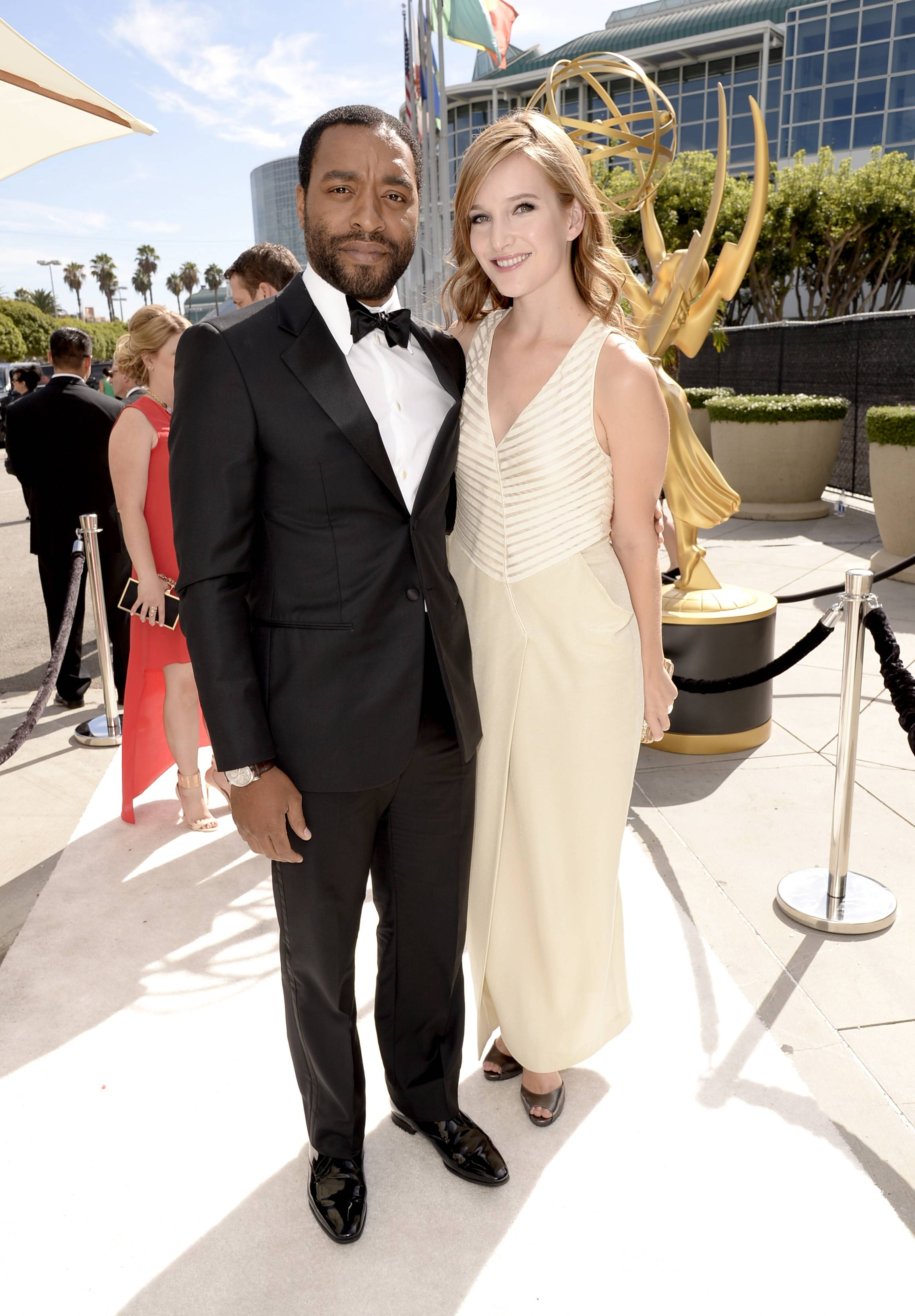Chiwetel Ejiofor, left, and Sari Mercer arrive at the 66th Primetime Emmy Awards at the Nokia Theatre.