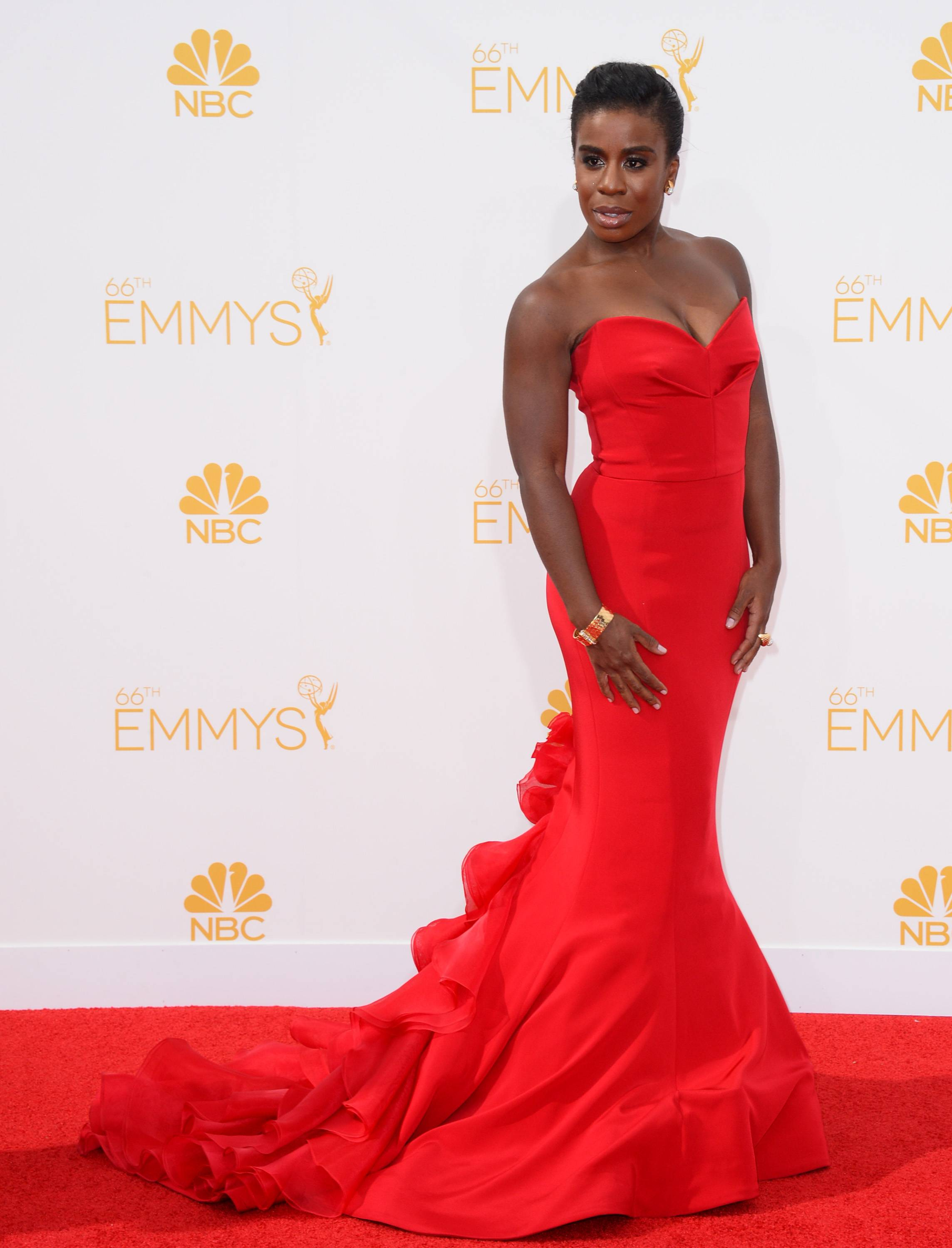 Uzo Aduba arrives at the 66th Annual Primetime Emmy Awards at the Nokia Theatre L.A. Live on Monday, Aug. 25, 2014, in Los Angeles. (Photo by Jordan Strauss/Invision/AP)