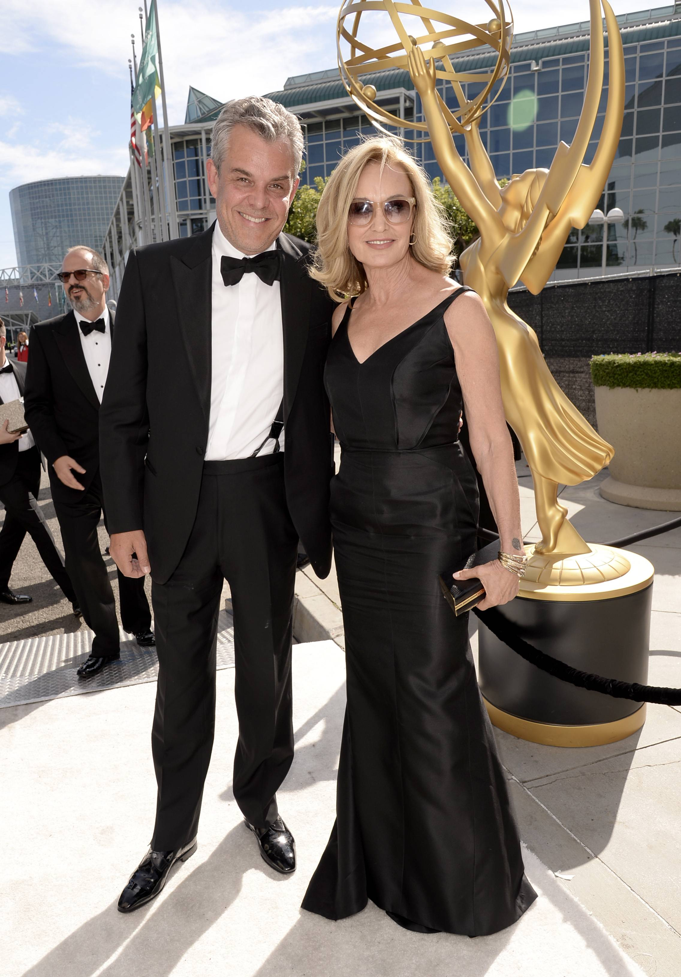 Danny Huston, left, and Jessica Lange arrive at the 66th Primetime Emmy Awards at the Nokia Theatre.