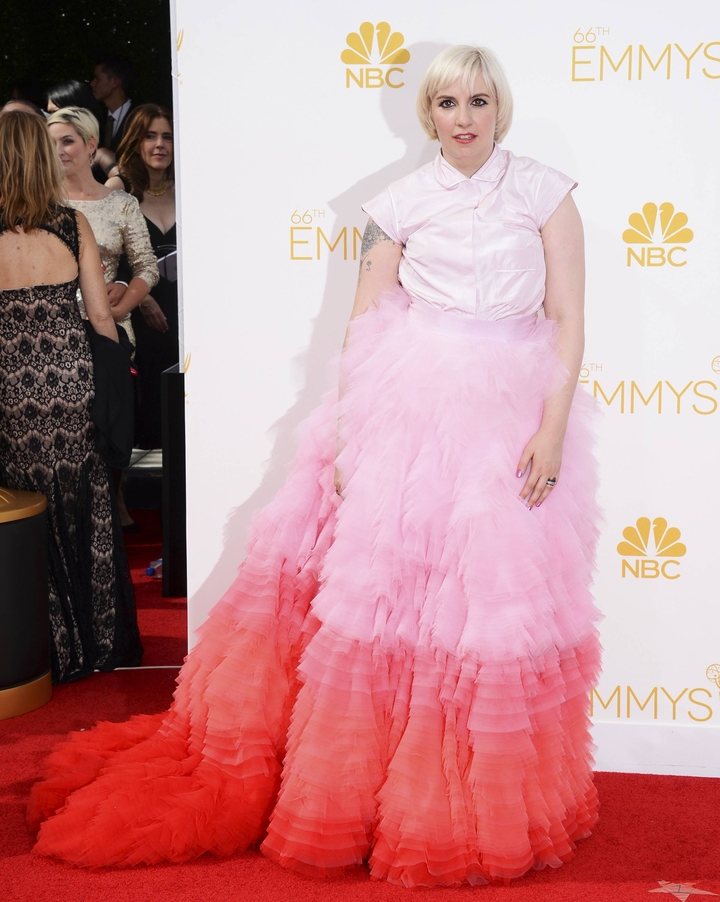 Lena Dunham arrives at the 66th Annual Primetime Emmy Awards at the Nokia Theatre.