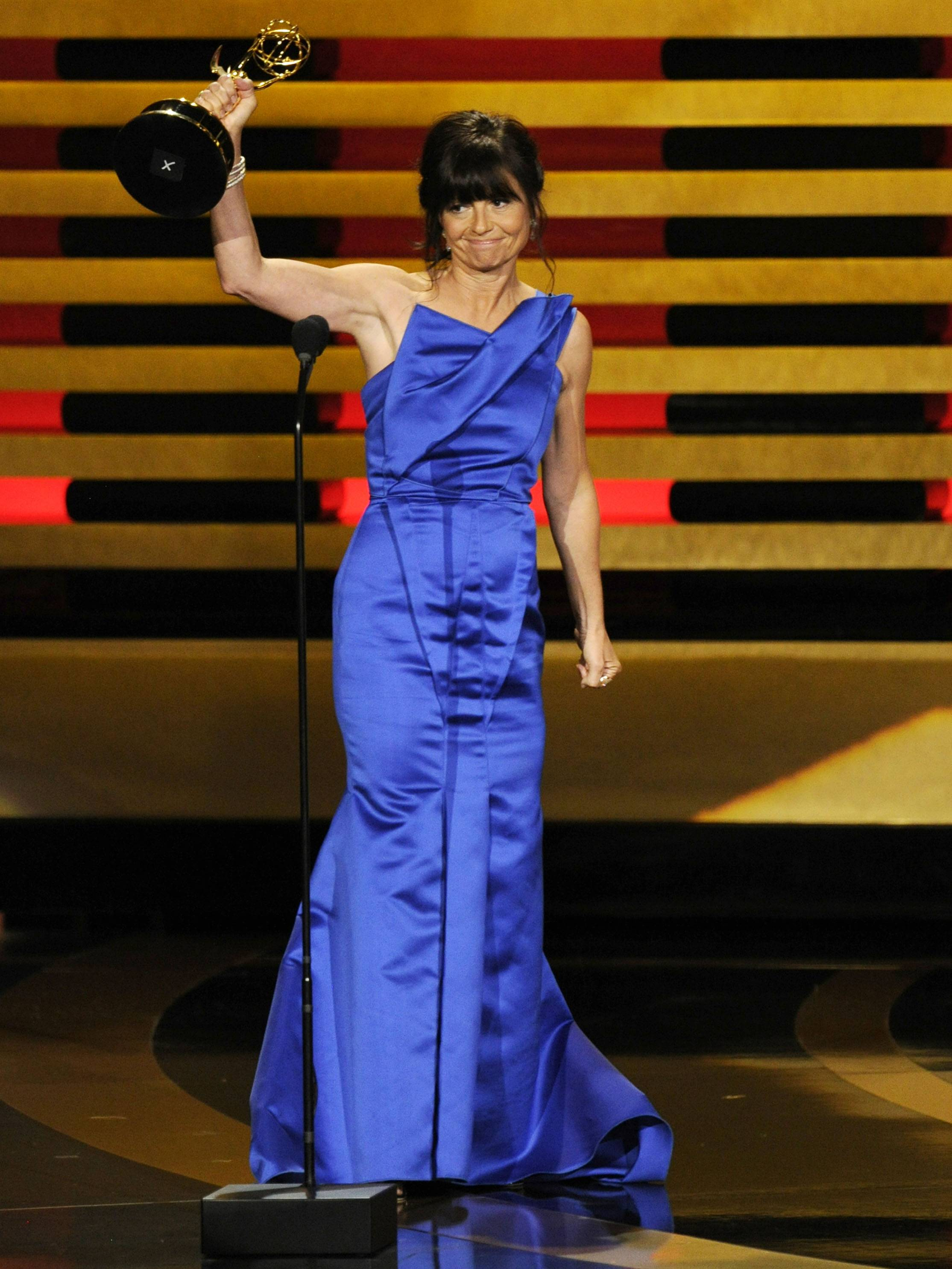 "Gail Mancuso accepts the award for outstanding directing for a comedy series for her work on ""Modern Family"" at the 66th Annual Primetime Emmy Awards at the Nokia Theatre."