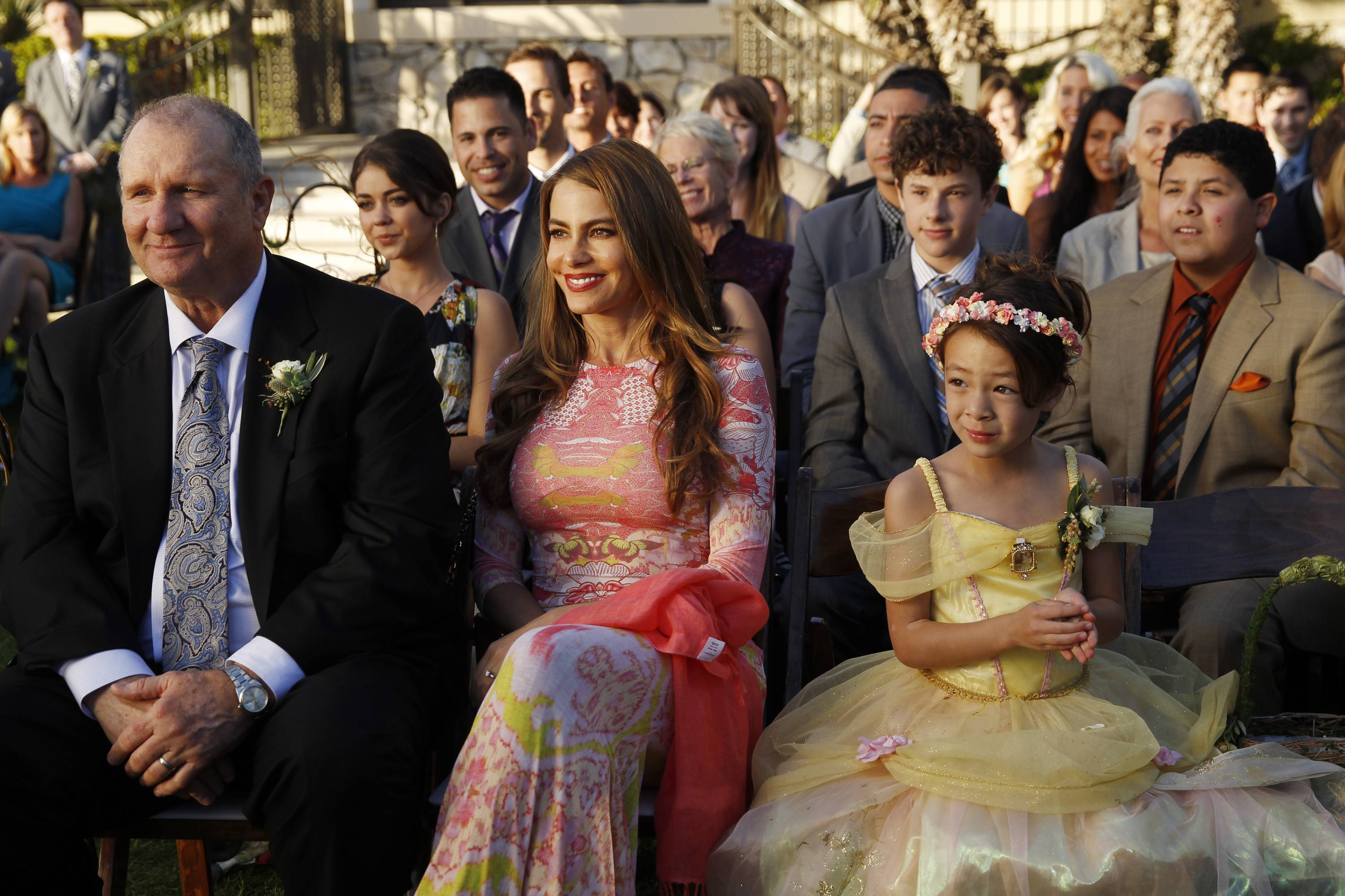 "This photo released by ABC shows, from left, Ed O'Neill, Sarah Hyland, Sofia Vergara, center, Nolan Gould, Aubrey Anderson-Emmons and Rico Rodriguez in a scene from ""The Wedding, Part 2,"" during the season finale of ""Modern Family."""