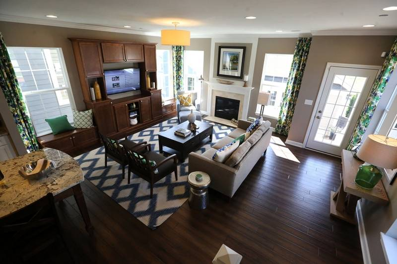 Chelsea model home opens at arlington market Model home family room pictures