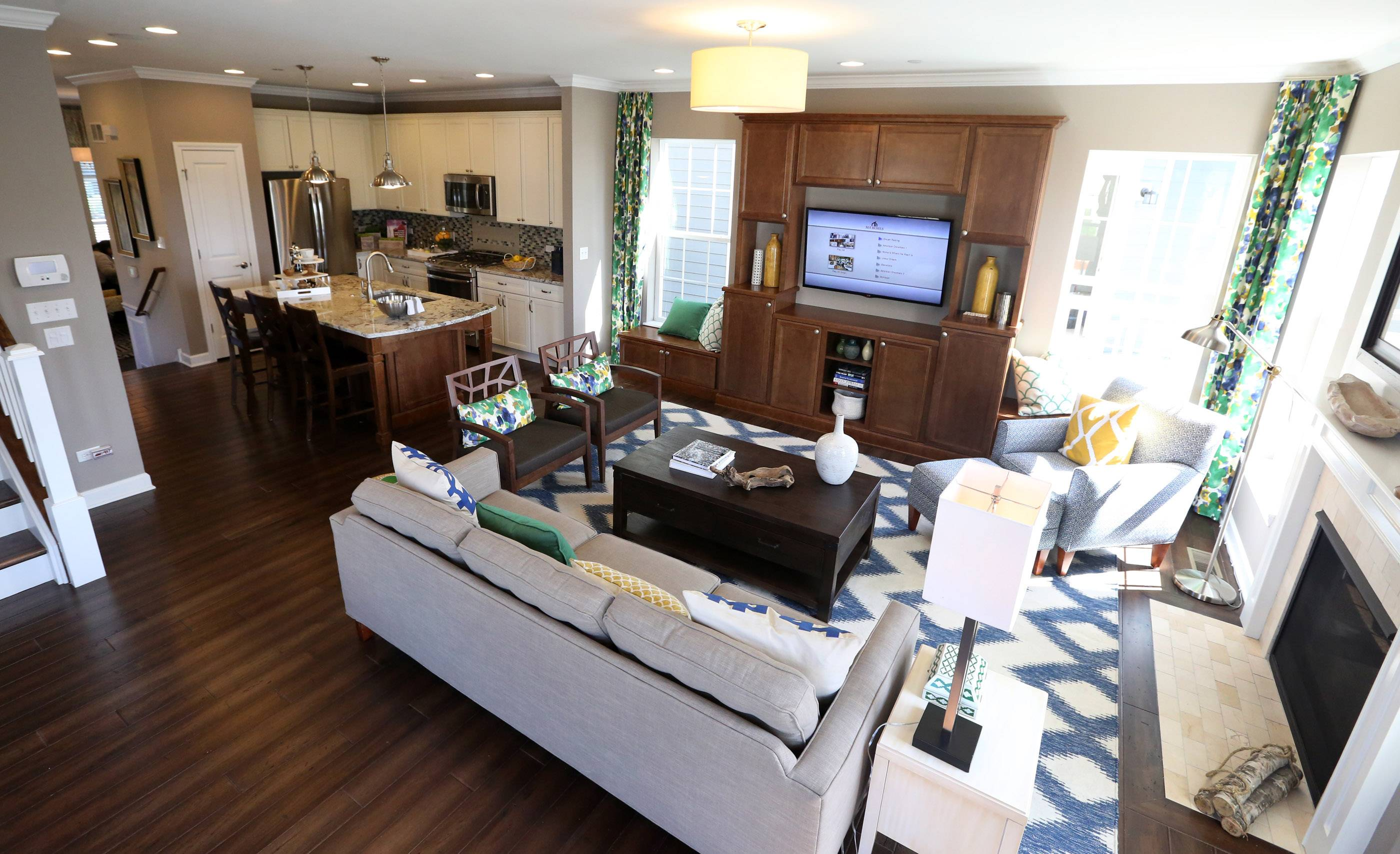 Living room and kitchen in Chelsea model at Arlington Market in Arlington Heights.