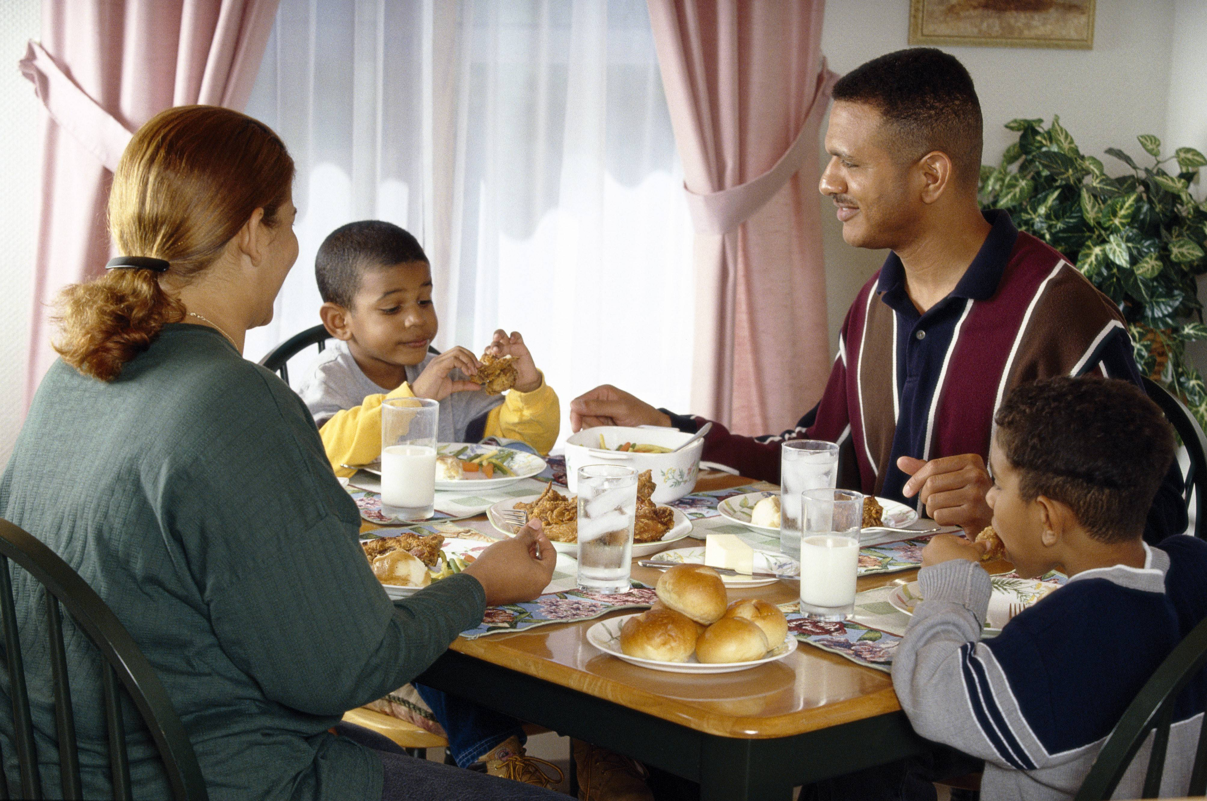 For more mindful eating, children should eat with caring adults in a happy setting and without distraction, not in front of the TV or in the car.
