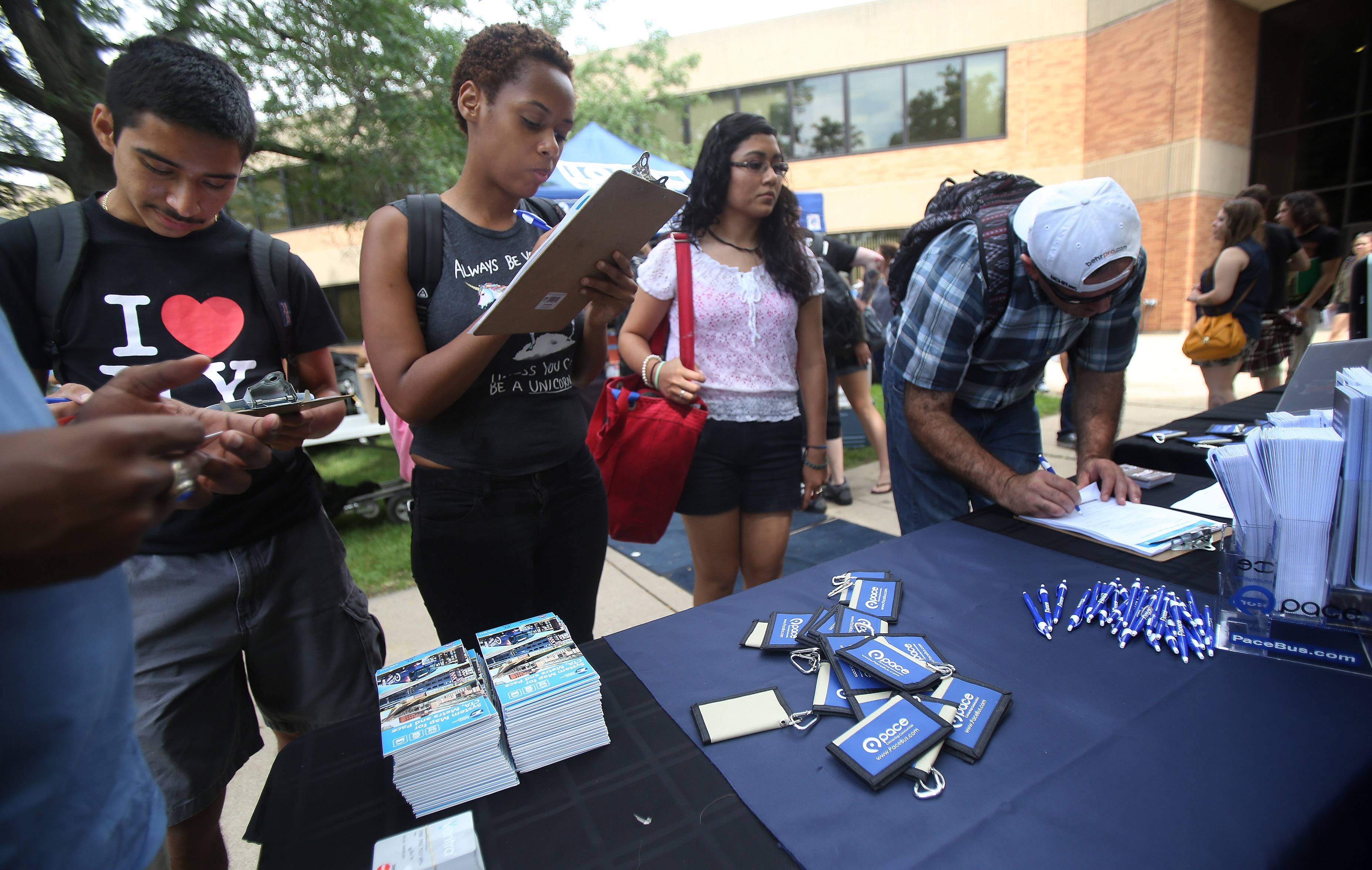 College of Lake County students fill out forms for the Pace Campus Connection card during the first day of classes Monday. For $175, students can ride any Pace bus in the suburbs during the semester.