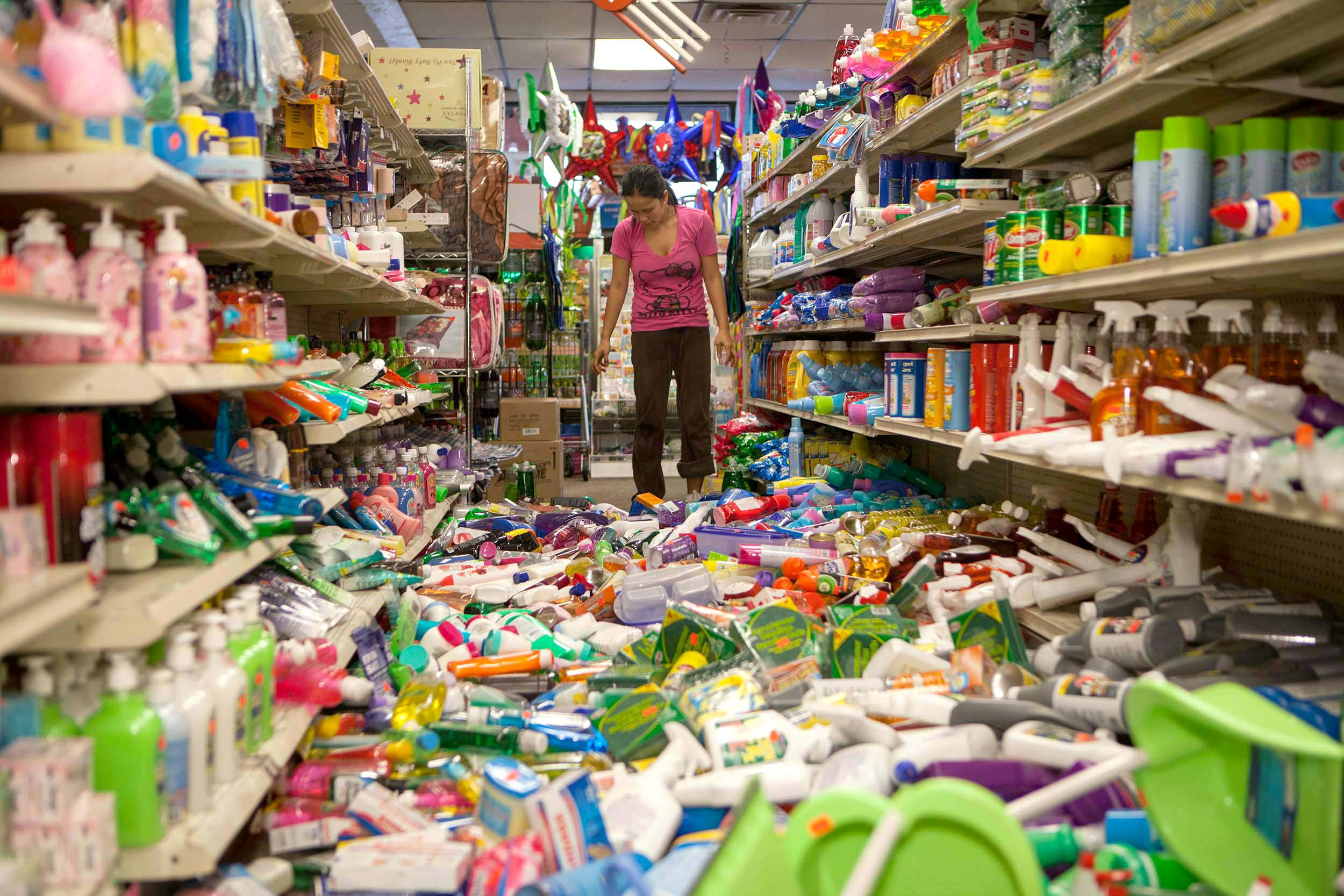 Nina Quidit cleans up the Dollar Plus and Party Supplies Store Sunday in American Canyon, California, after an earthquake. Quidit and her husband were woken up in the early morning hours by the store's alarm company and immediately drove in to begin clean up. The 6.0-magnitude quake caused six significant fires, including at four mobile homes, Napa Division Fire Chief Darren Drake said.