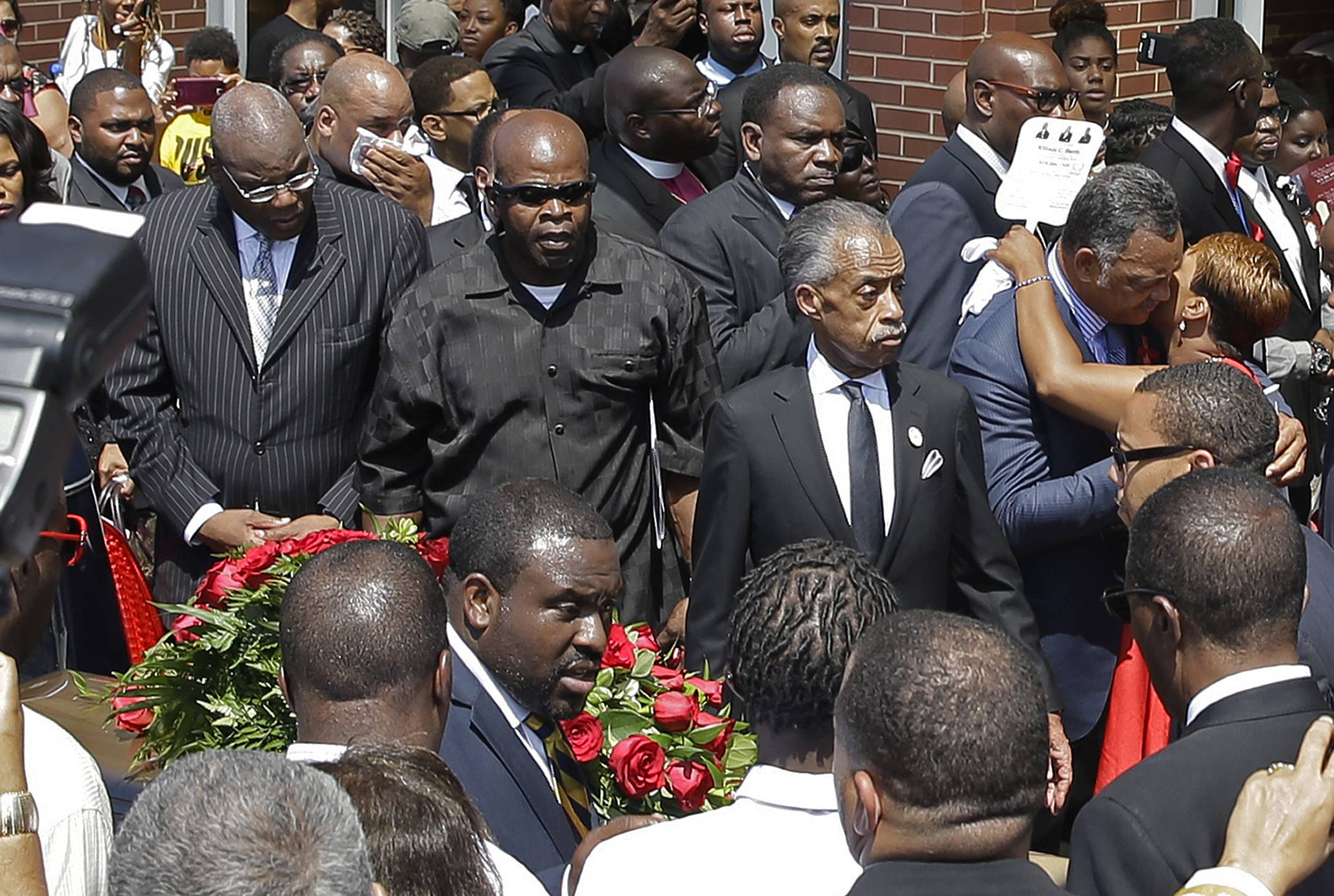 Michael Brown's mother, Lesley McSpadden, right, hugs the Rev. Jesse Jackson as the casket of Michael Brown is carried to a hearse after the funeral service for Michael Brown on Monday in St. Louis.