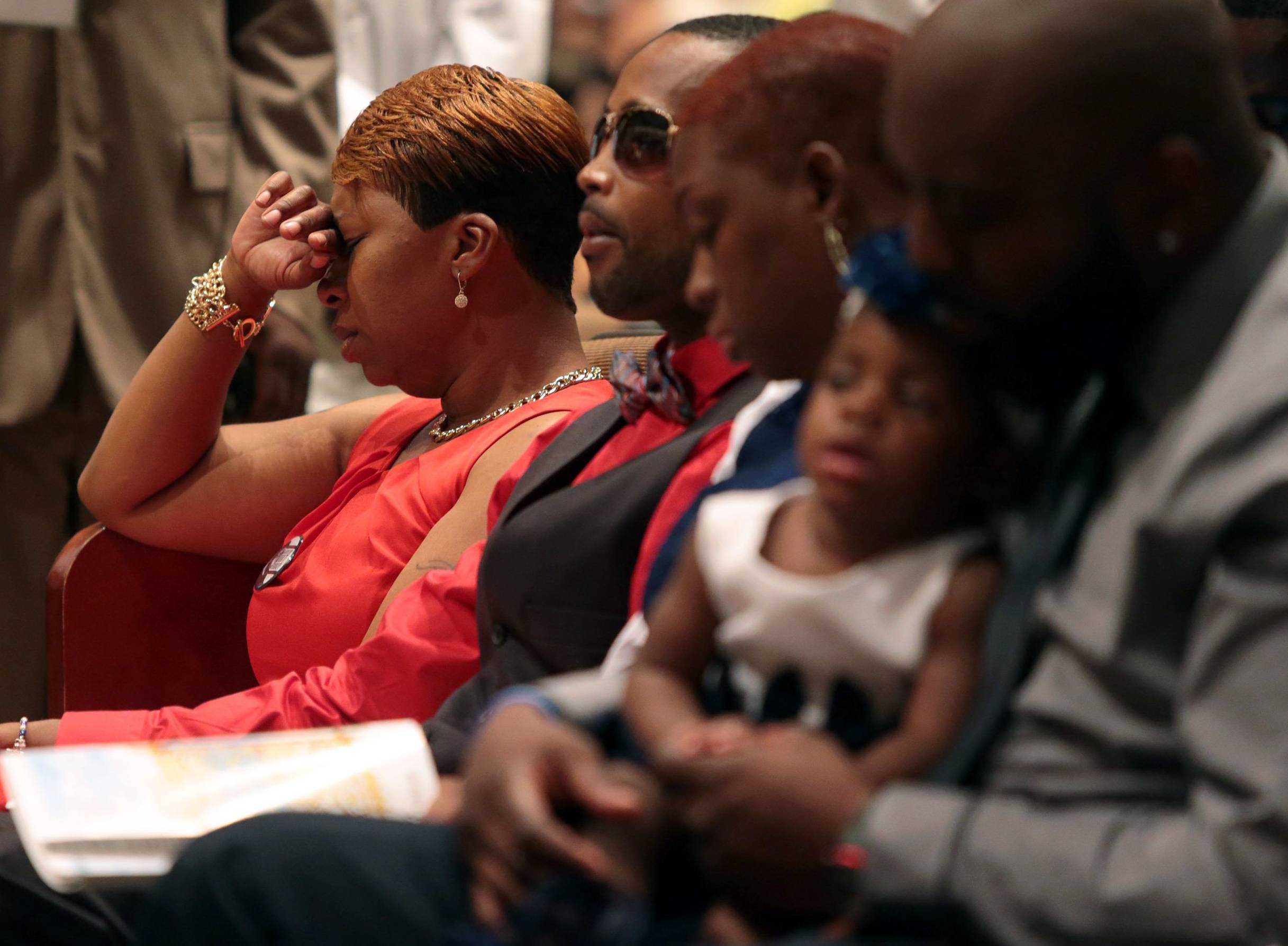 Lesley McSpadden, left, Michael Brown's mother, closes her eyes during the funeral service for her son at Friendly Temple Missionary Baptist Church in St. Louis.