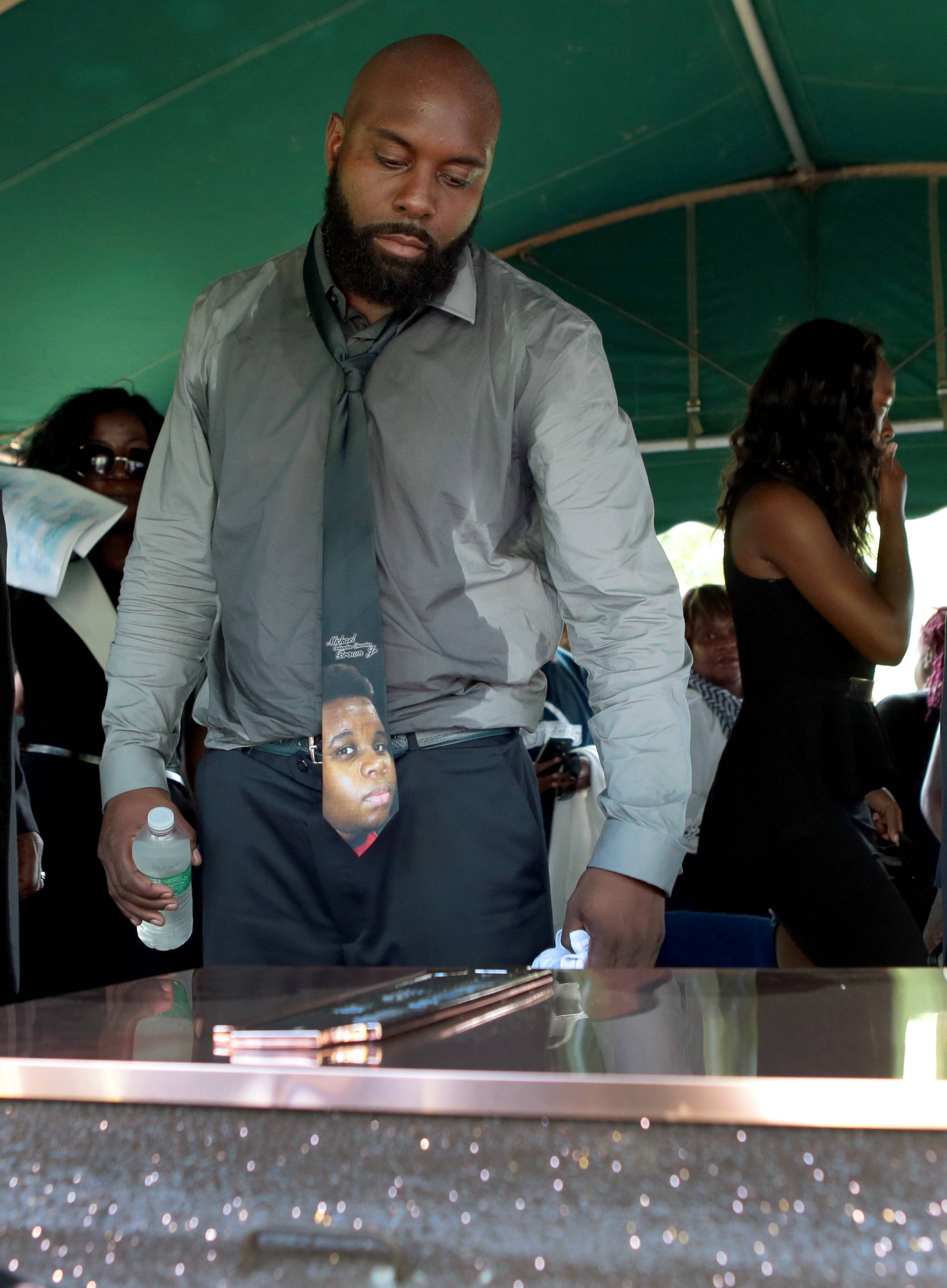 Michael Brown Sr. looks over his son's burial vault during the funeral for Michael Brown on Monday.