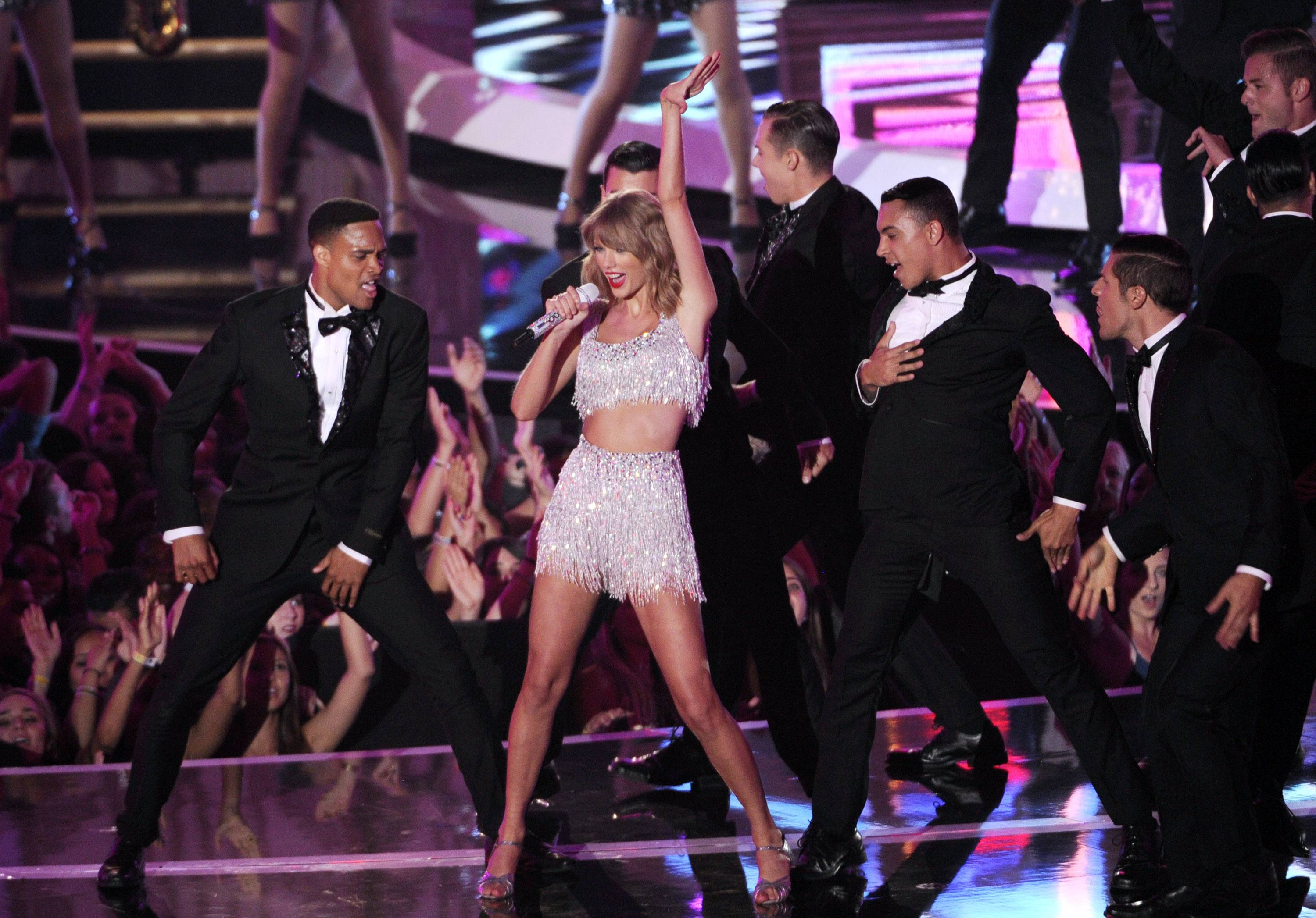 "Taylor Swift performs her new single ""Shake It Off"" Sunday at the MTV Video Music Awards."