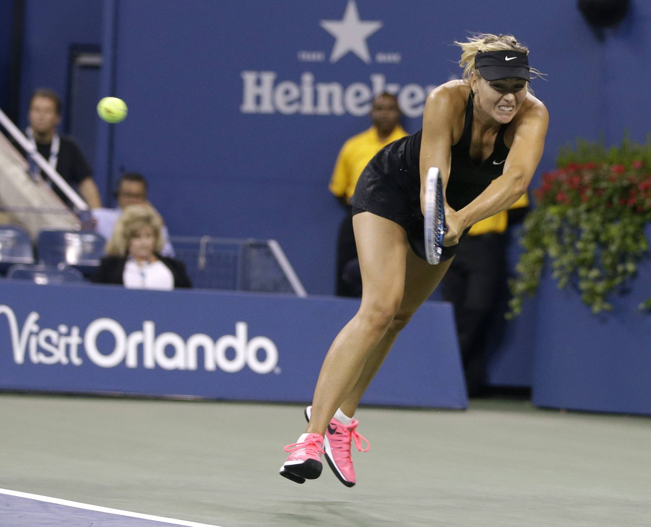Maria Sharapova returns a shot to Maria Kirilenko on Monday during the opening round of the U.S. Open in New York.