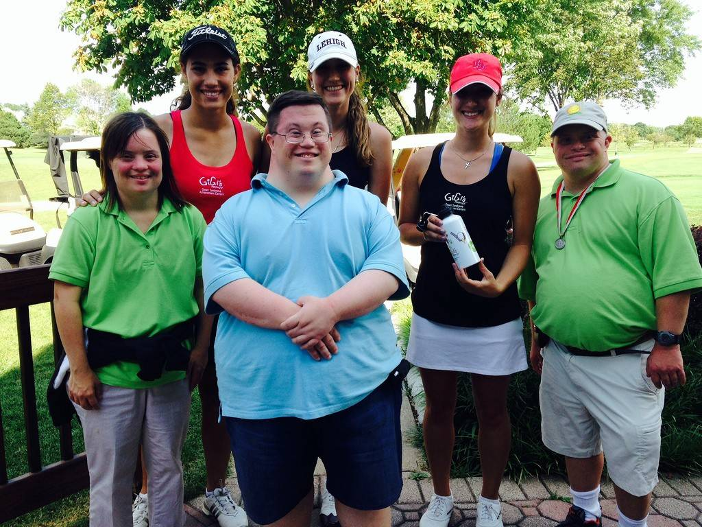 Volunteers Jacki Berardi, Nicole Feierberg and Tina Berardi with Hugs + Mugs interns at the GiGi's Playhouse National Achievement Center's first golf outing.