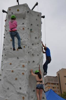 Families enjoy the climbing wall at last year's Waukegan Public Library Monarch Festival.