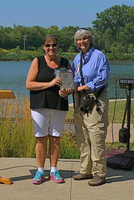 River Corridor Foundation of St. Charles President Holly Cabel presents the 2014 Individual Golden Turtle Award to Pam Otto, manager of nature programs and interpretive services at St. Charles Park District.