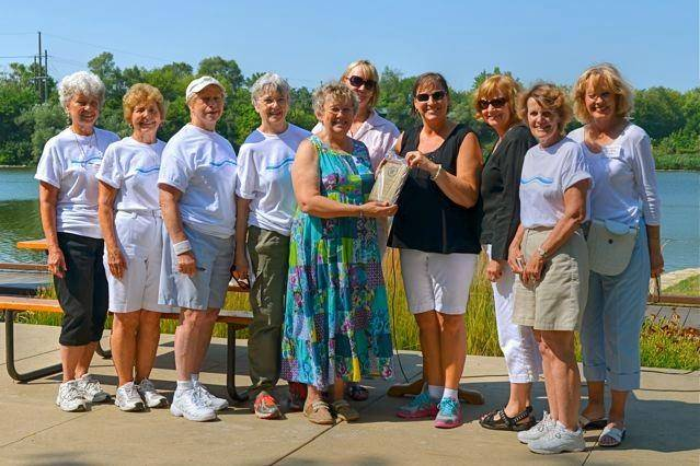 Holly Cabel, president of the River Corridor Foundation of St. Charles, presents the 2014 Golden Turtle Group Award to the Pottawatomie Garden Club.