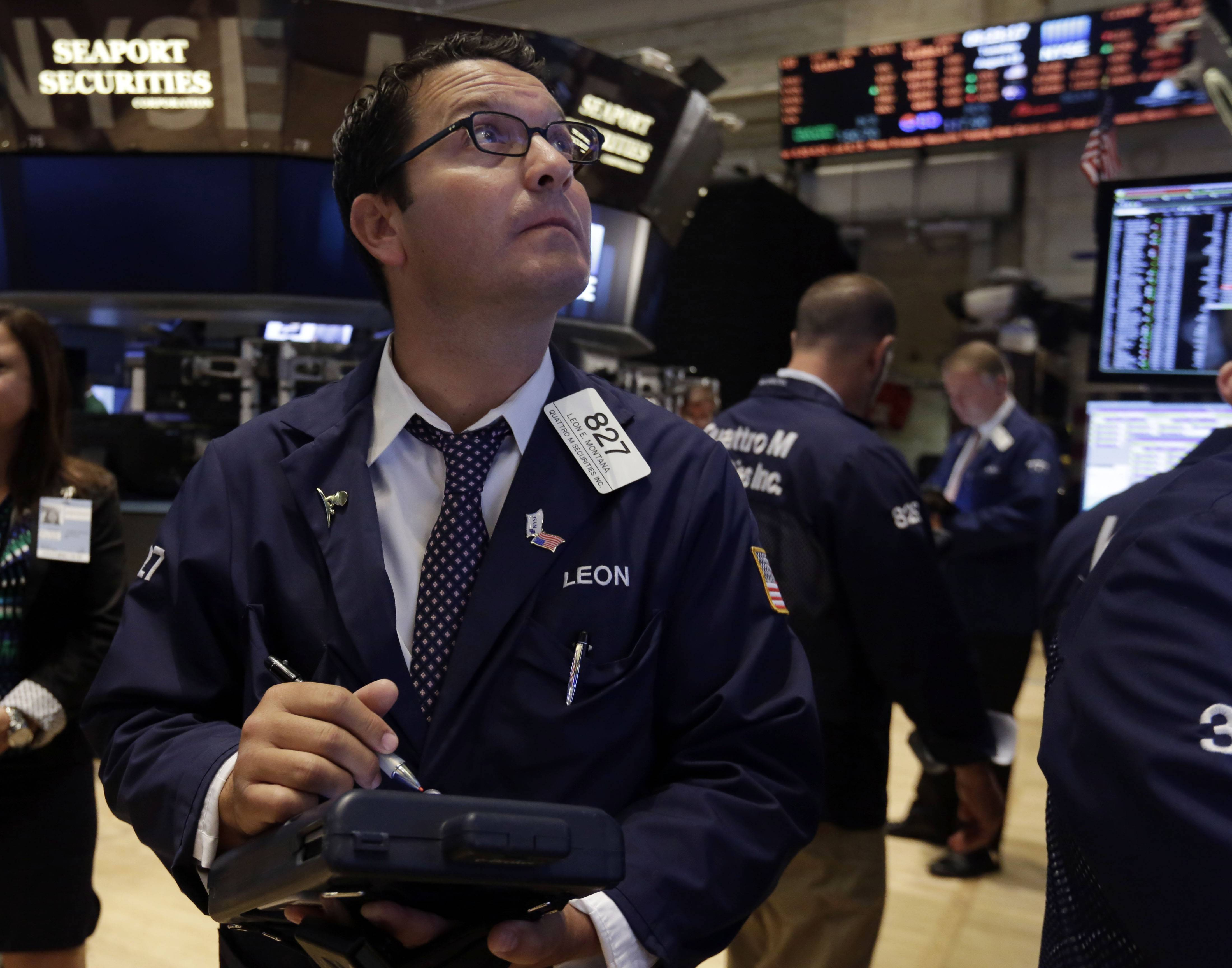 The Standard & Poor's 500 index closed above 2,000 points for the first time Tuesday. Financial markets moved higher after some encouraging news, including a surge in consumer confidence. The Dow Jones industrial average is about 32 points below the record close it set on July 16, while the Nasdaq remains well below its dot-com era high of 5,048.62 set in March 2000.