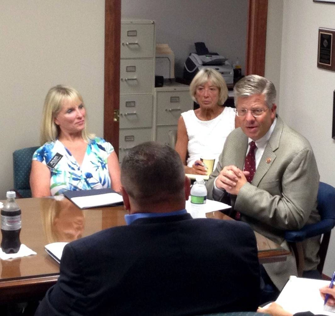 Congressman Randy Hultgren, right, hosted a discussion with local parents, educators and school board members Monday night to see what assistance he can offer in addressing any pitfalls with Illinois' adoption of Common Core standards.