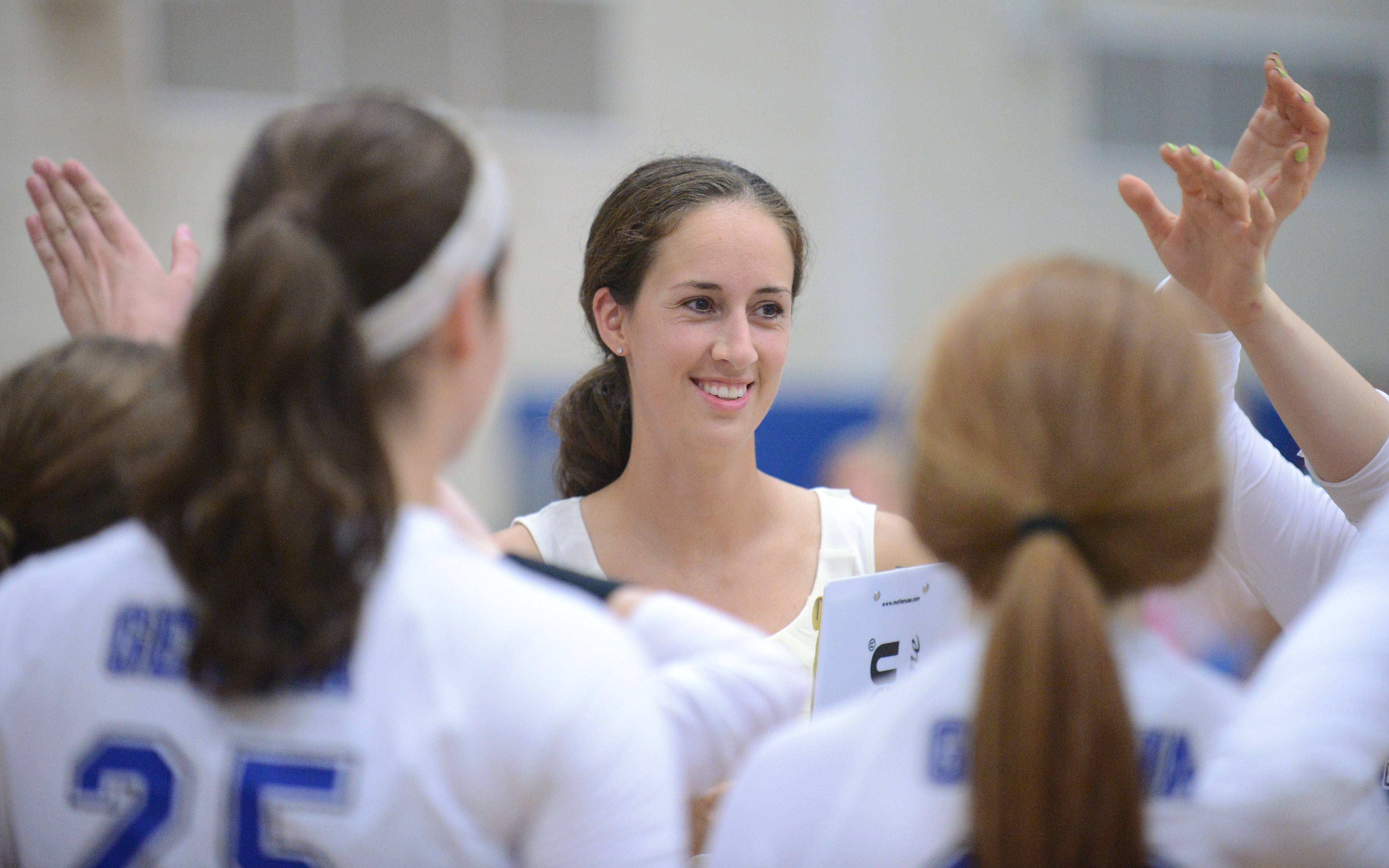 New Geneva girls volleyball coach Annie Seitelman had a lot to smile about in the Vikings' 25-18, 25-21 win over Rosary Tuesday.