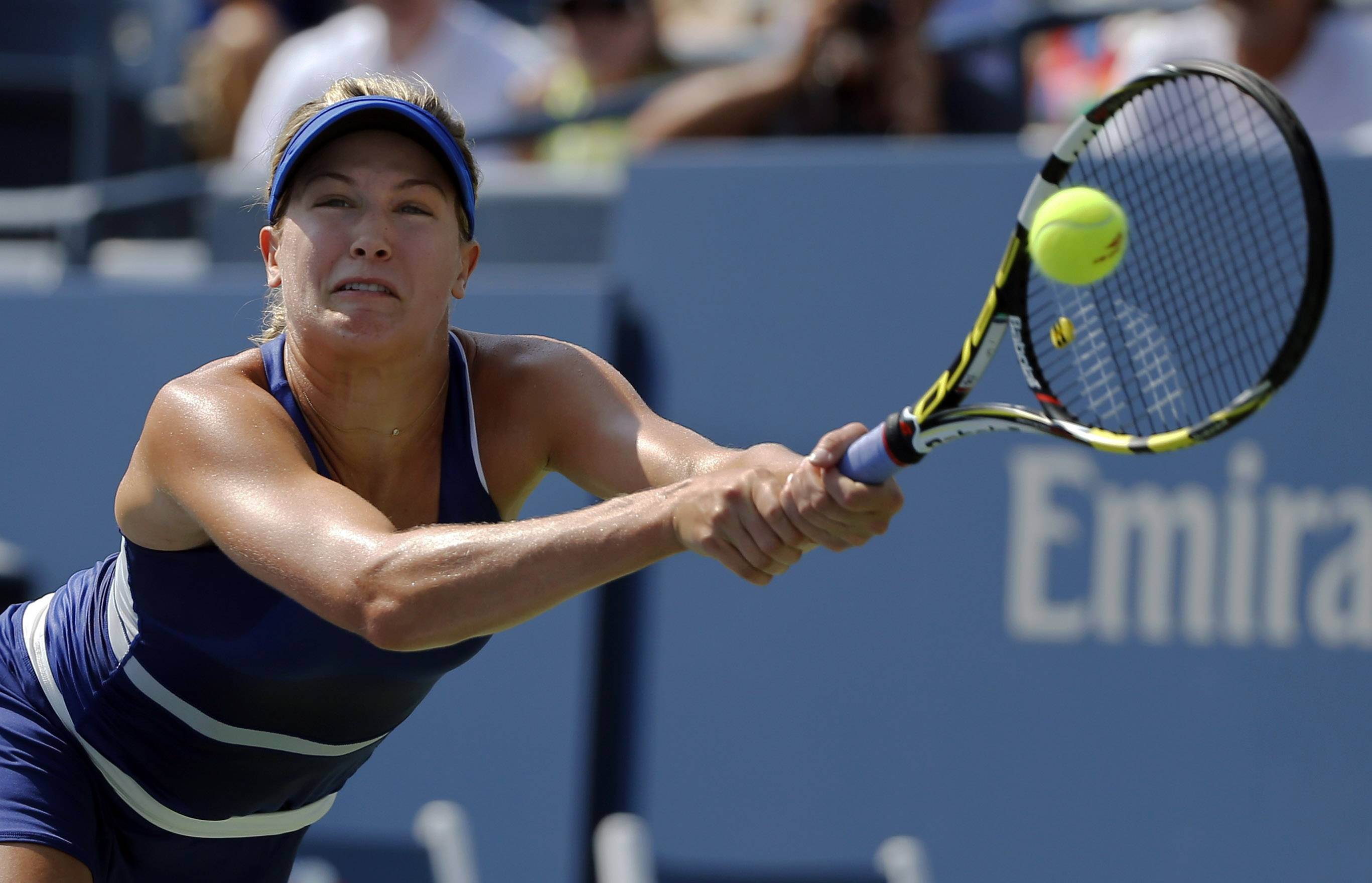Eugenie Bouchard, of Canada, returns a shot against Olga Govortsova, of Belarus, during the first round of the 2014 U.S. Open tennis tournament, Tuesday, Aug. 26, 2014, in New York. (AP Photo/Elise Amendola)