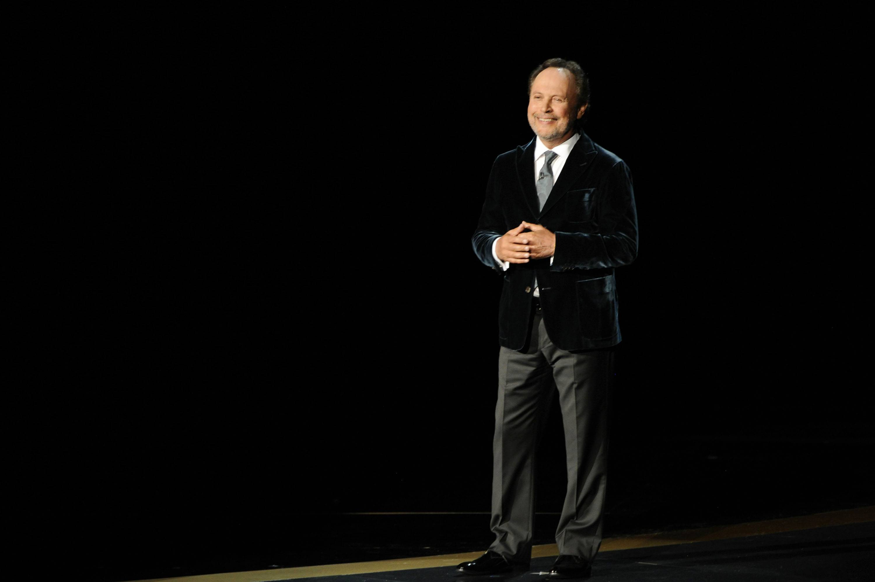 Billy Crystal speaks during an In Memoriam tribute to Robin Williams at the 66th Annual Primetime Emmy Awards at the Nokia Theatre in L.A. on Monday.
