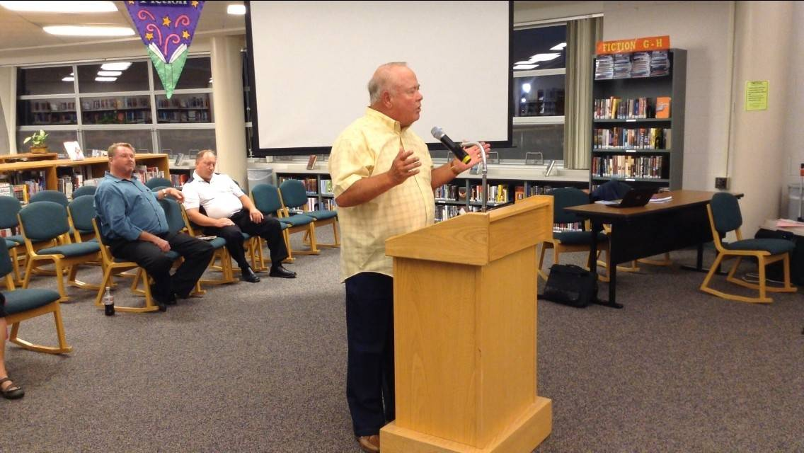 Libertyville resident Gerry Verbeten implores Libertyville-Vernon Hills Area High School District 128 officials to cut spending during Monday's board meeting.