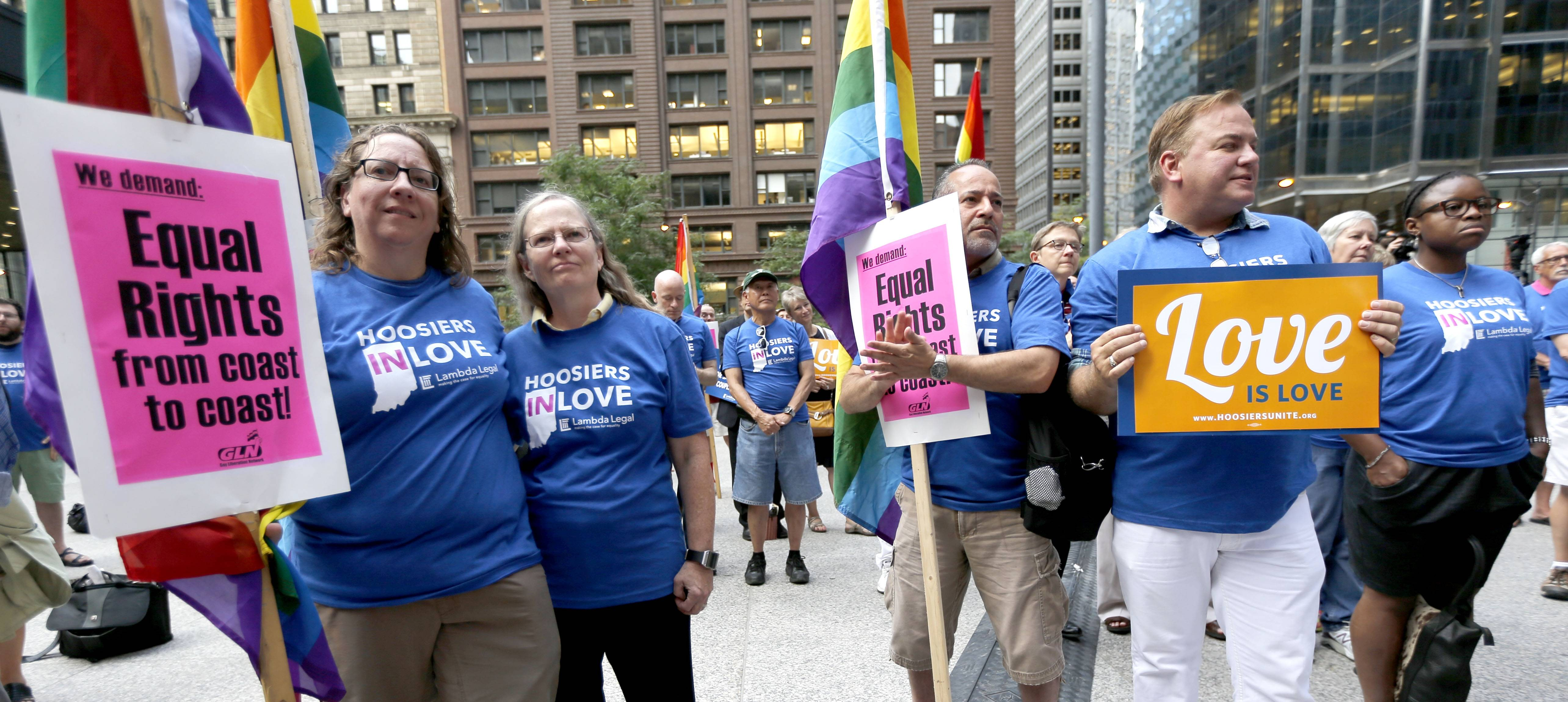 Supporters of gay marriage in Wisconsin and Indiana attend a rally at the federal plaza Monday, Aug. 25, 2014, in Chicago. The Chicago-based 7th U.S. Circuit Court of Appeals will hear arguments Tuesday on gay marriage fights from Indiana and Wisconsin, setting the stage for one ruling. Each case deals with whether statewide gay marriage bans violate the Constitution.