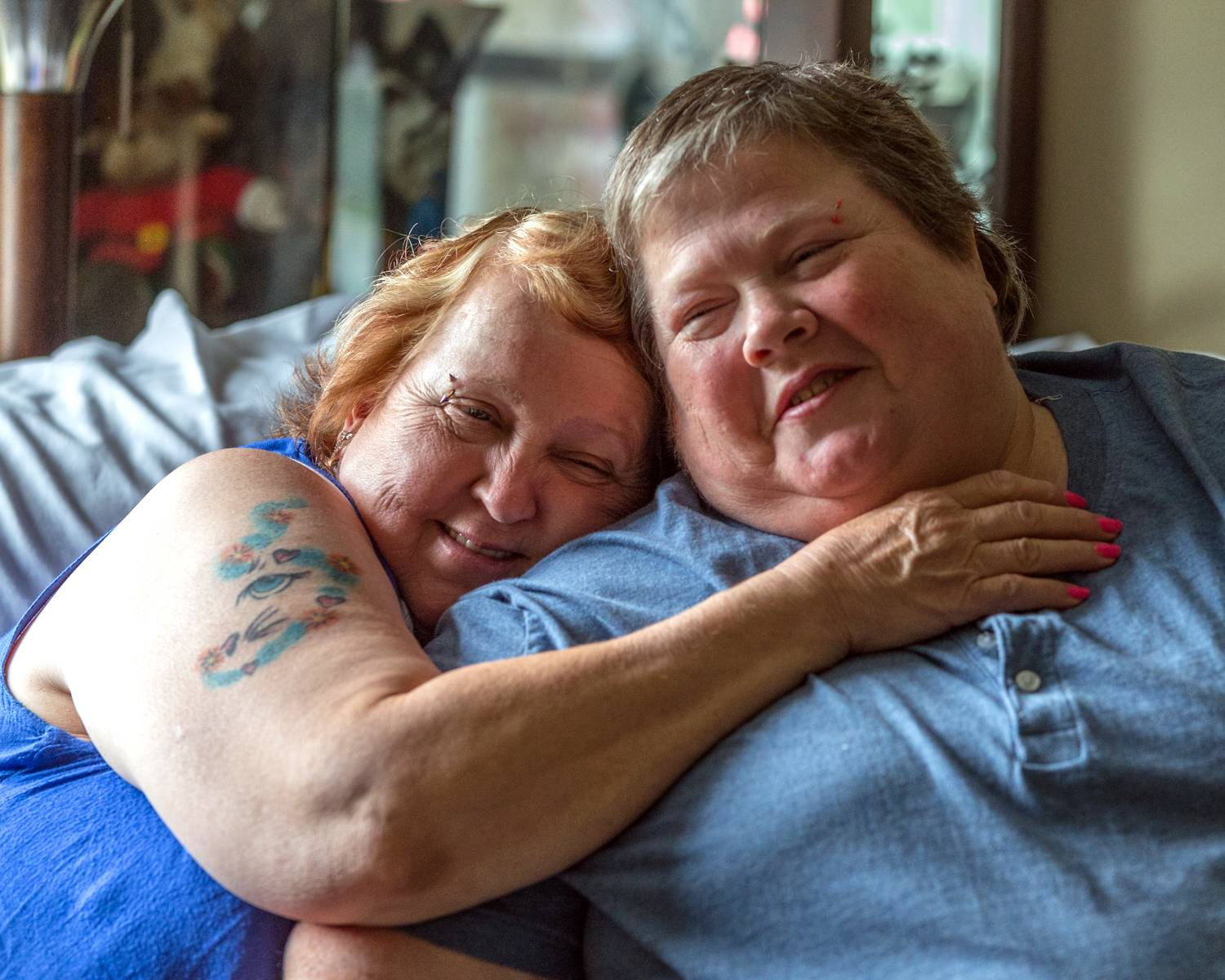 Lyn Judkin, left, and Bonnie Everly in Chesterton, Ind. For the Indiana couple, who've been together more than 13 years, a health crisis Everly experienced this spring drove home the plight they and other gay and lesbian couples face in states such as Indiana that ban gay marriage.