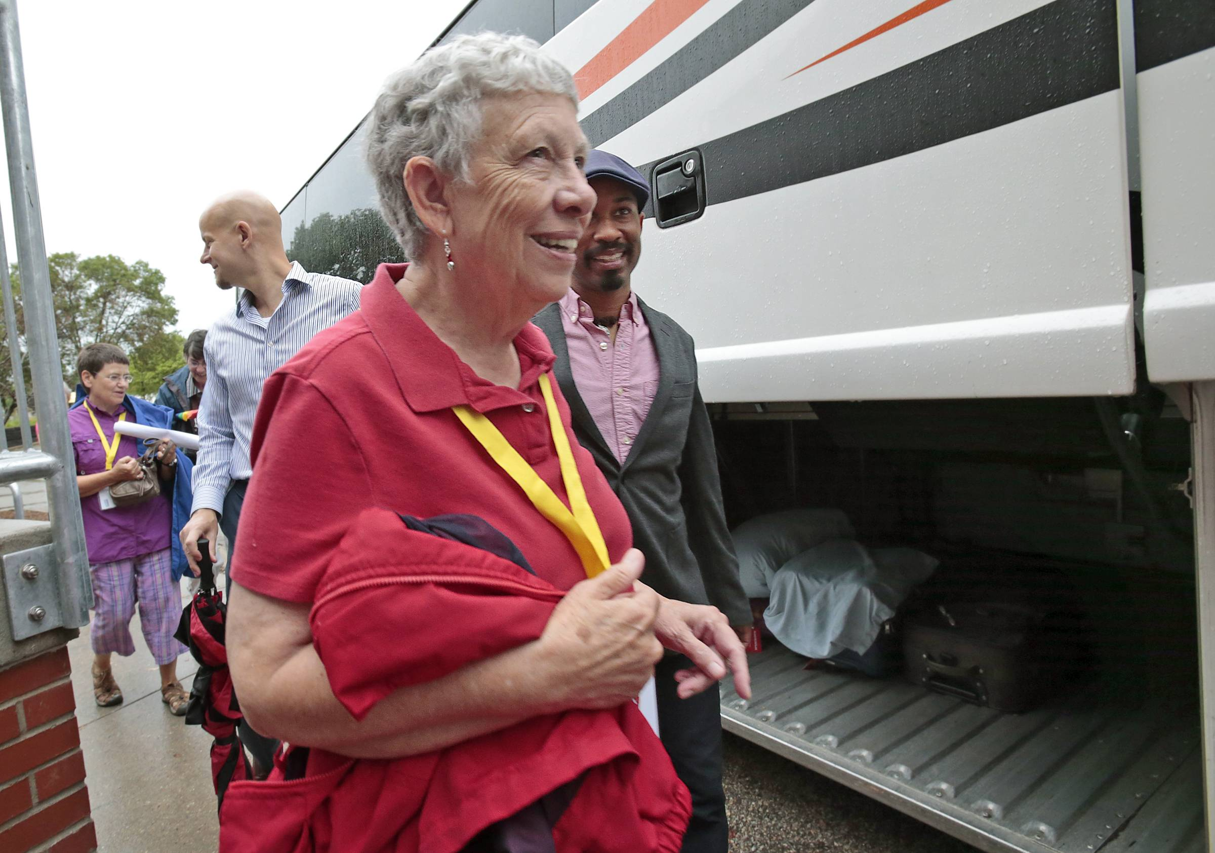 Virginia Wolf, one of several named plaintiffs in Wolf v. Walker which challenges Wisconsin's ban on same-sex marriage, walks with fellow plaintiffs to a bus during Wisconsin Unites for Marriage's Marriage Bus Tour.