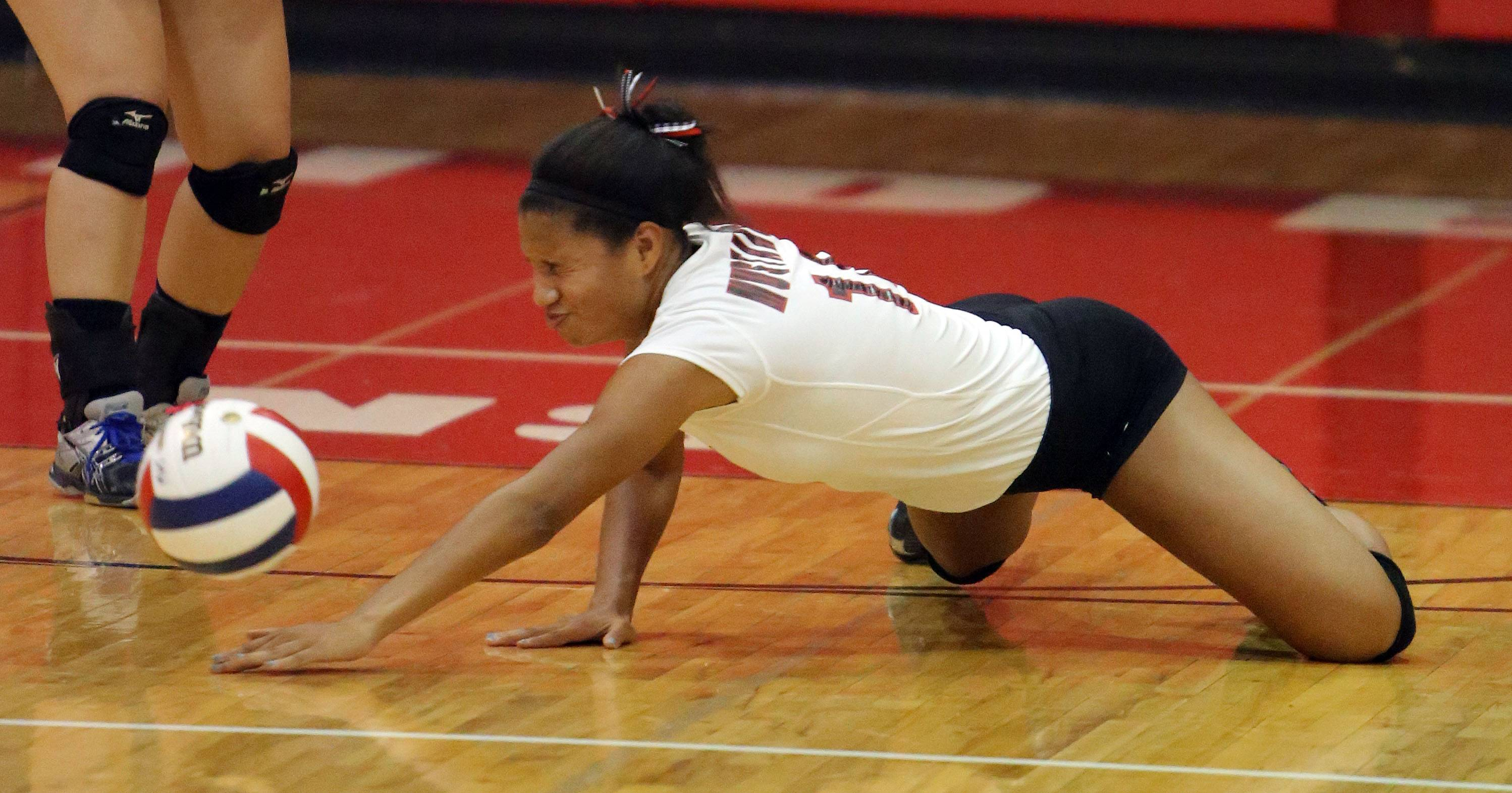 Mundelein's Yasmeen Johnson dives for a ball during their game against Wauconda on Tuesday night at Mundelein.