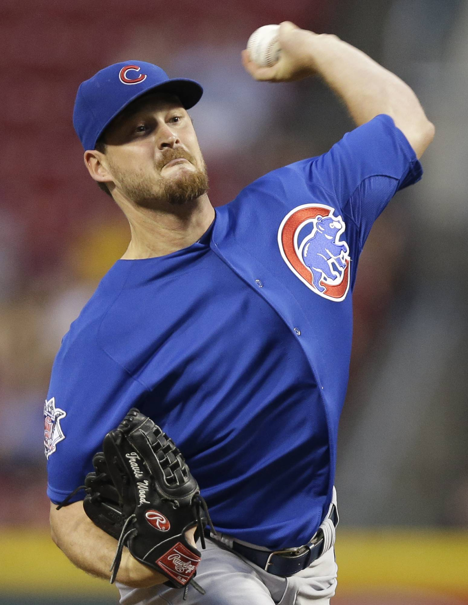 Chicago Cubs starting pitcher Travis Wood throws against the Cincinnati Reds in the first inning of a baseball game, Tuesday, Aug. 26, 2014, in Cincinnati.