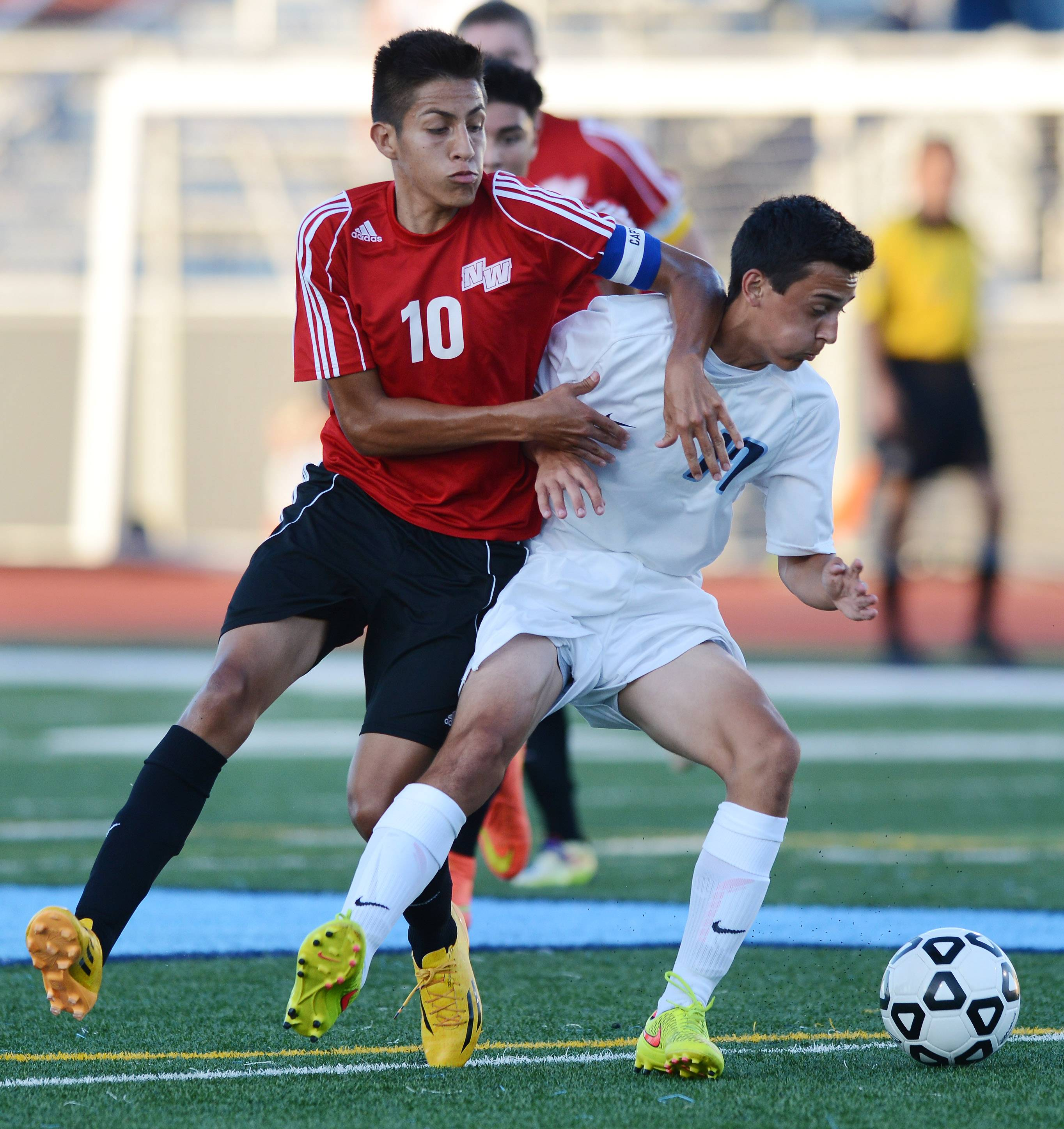 Anthony Morales of Niles West tries to get past Ross LaCamera of Prospect during Tuesday's game in Mount Prospect.