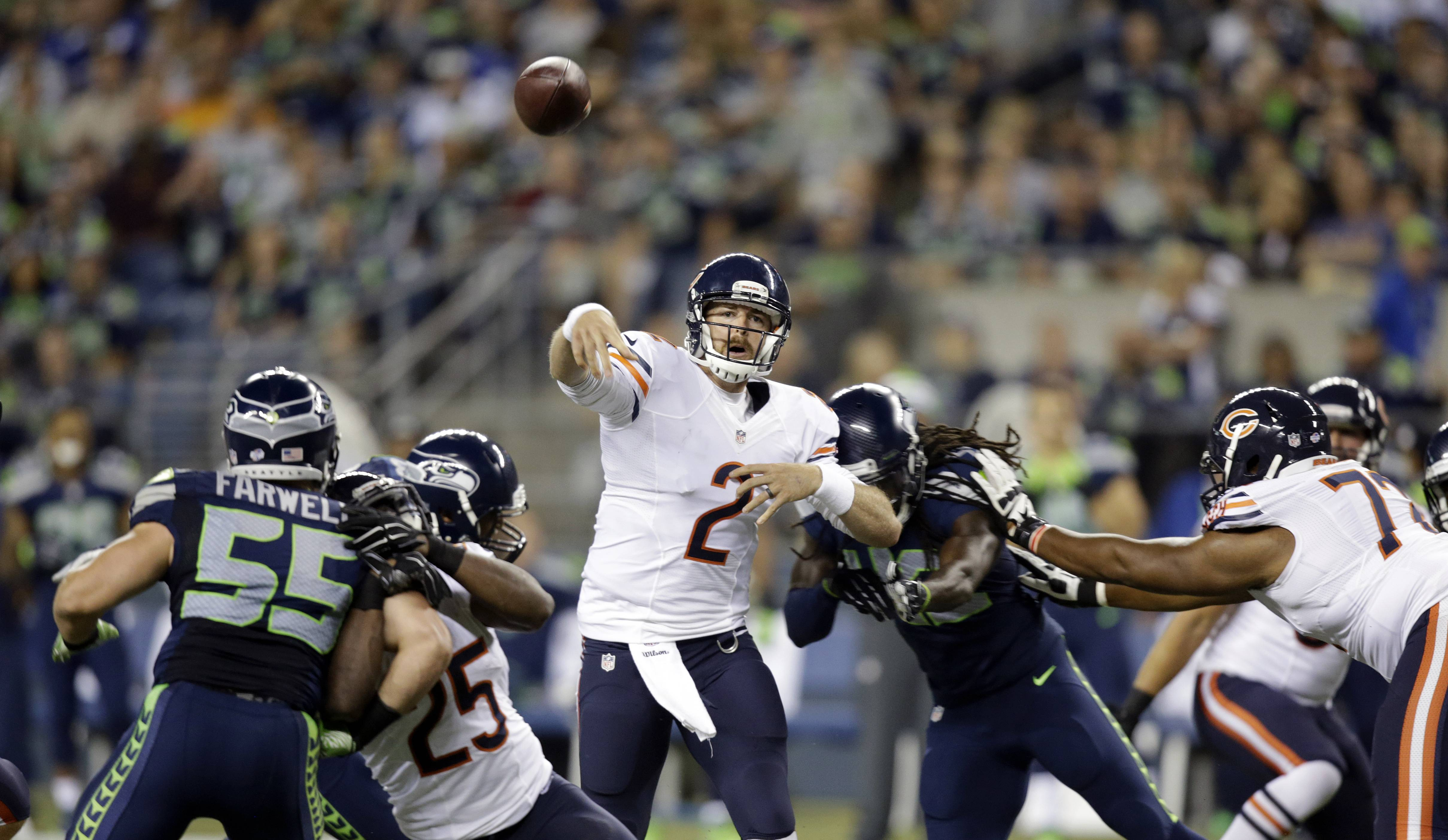 Chicago Bears quarterback Jordan Palmer (2) throws against the Seattle Seahawks in the second half of an preseason NFL football game, Friday, Aug. 22, 2014, in Seattle.