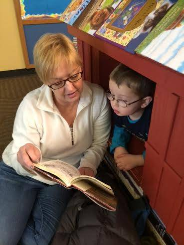 Susan Dennison, the library's communications manager, reads a story to her 3-year-old grandson, Drew Quagliana.Peter Quagliana