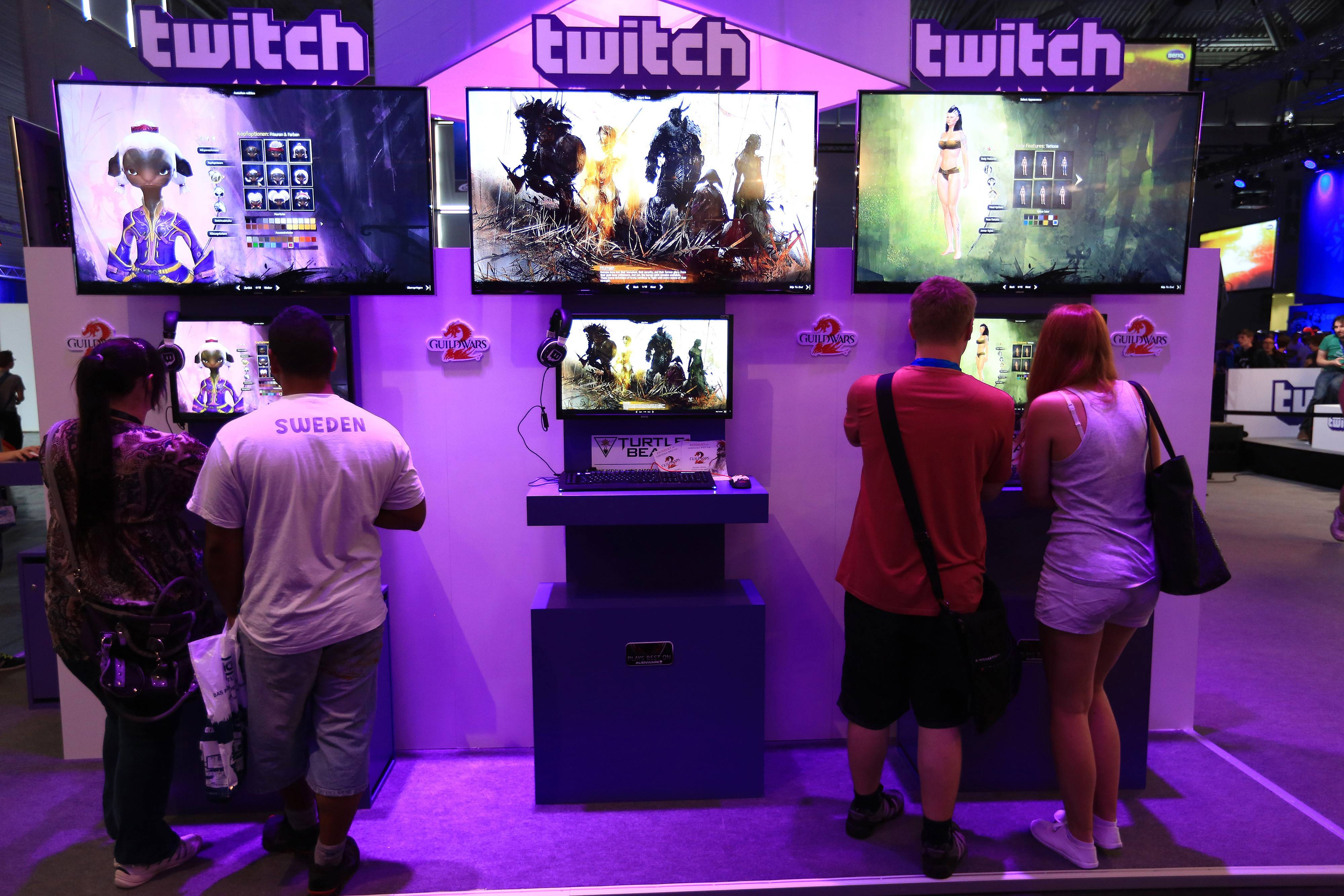 Visitors stream online computer games on the Twitch Interactive Inc. stand at Gamescom video games trade fair in Cologne, Germany.