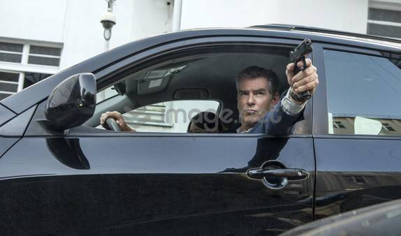 "Ex-CIA agent Peter Devereaux (erstwhile 007 Pierce Brosnan) gets lured out of retirement to race cars and shoot people with his left hand in ""The November Man."""