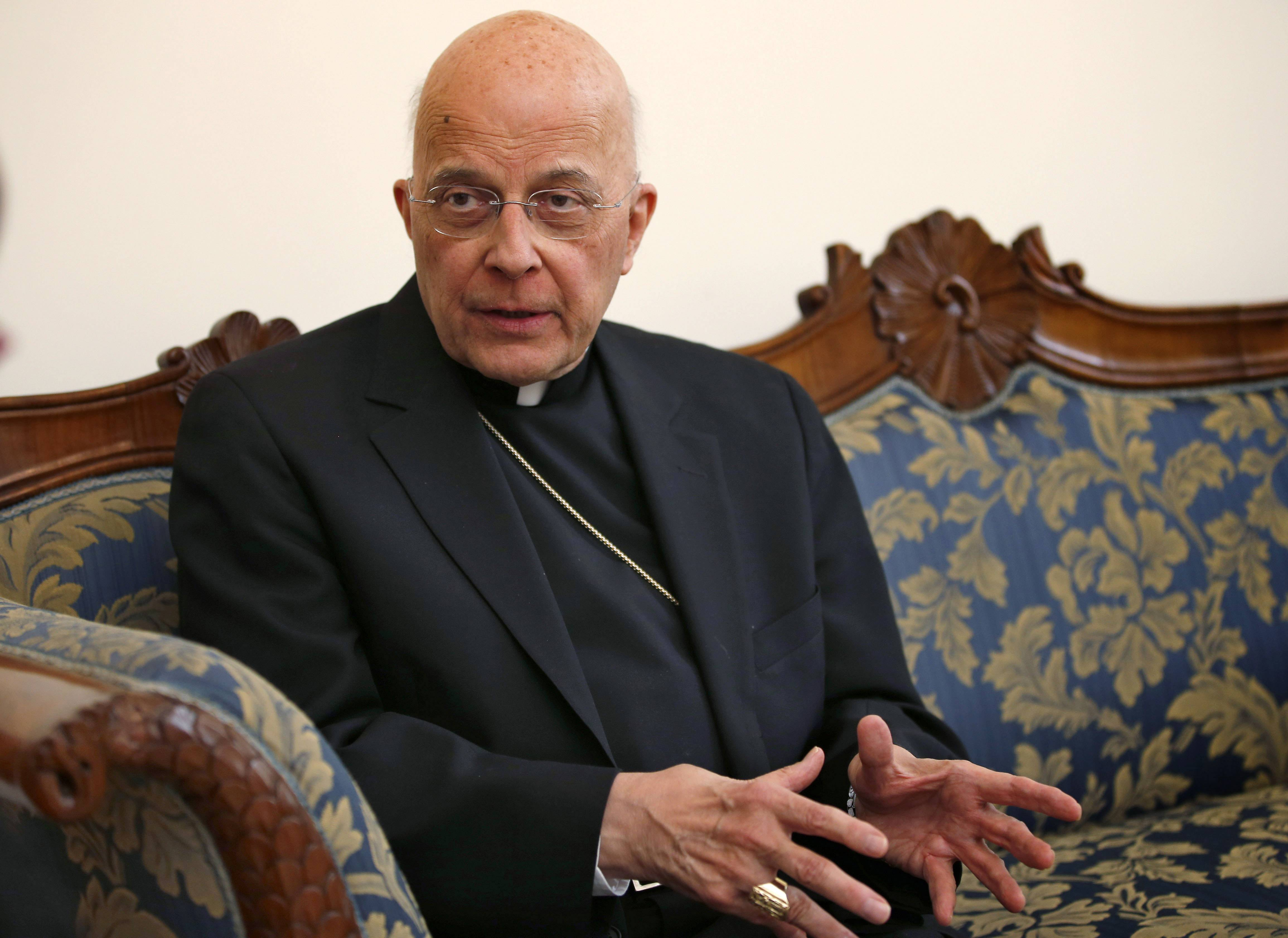 In this 2013 file photo, Cardinal Francis George speaks during an interview at the North American College in Rome. The Archdiocese of Chicago says George will not travel to Rome in October 2014 to meet with Pope Francis. Spokeswoman Colleen Dolan says the archbishop of Chicago had hoped to make that trip in mid-October but will not be able to because of medical treatment. She says the trip may be rescheduled.