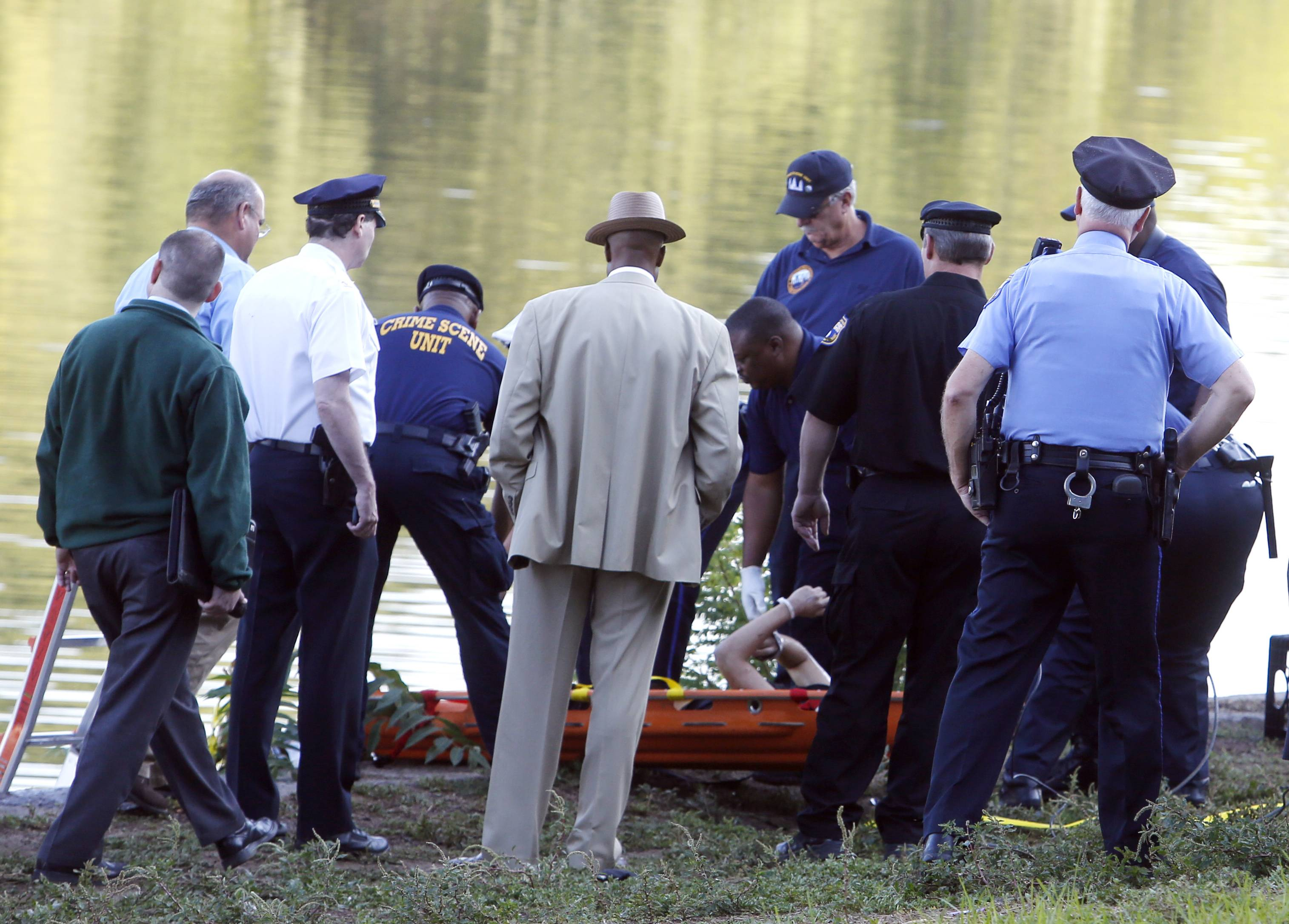 The bound bodies of two people were found in the Schuylkill River in Philadelphia Wednesday, and a third man who said he managed to free himself is being treated at a hospital for stab wounds, police said.