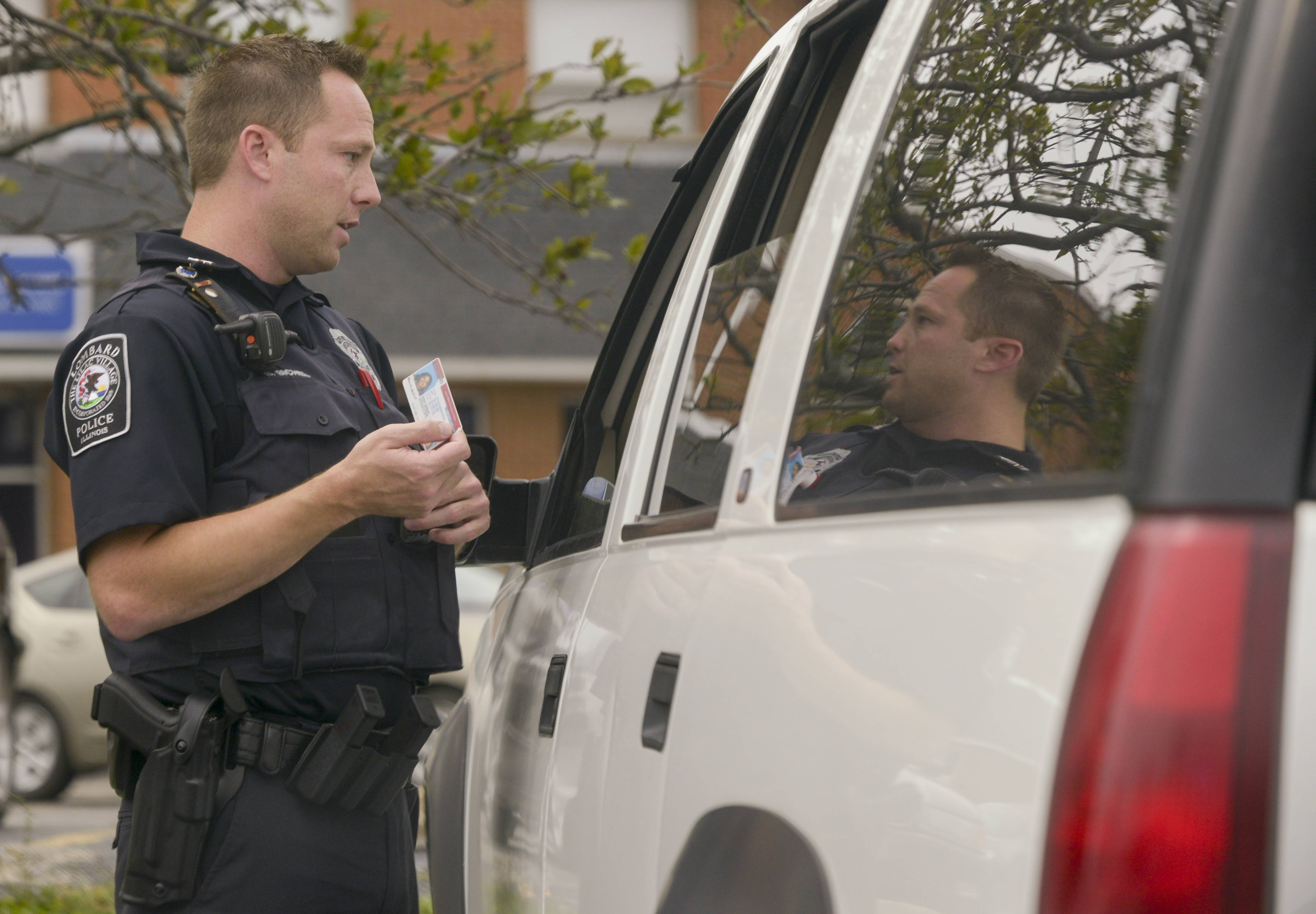 Lombard police officer Brad Bichel stops Wanda Hubbard of Maywood for talking on a cellphone. Hubbard, who normally uses a Bluetooth device but had forgotten it, was let off with a warning.