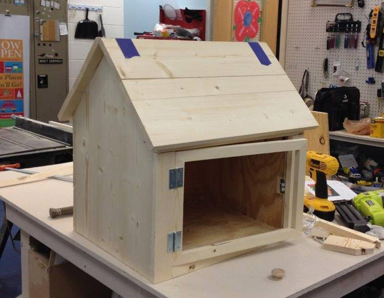 A Little Free Library being built.