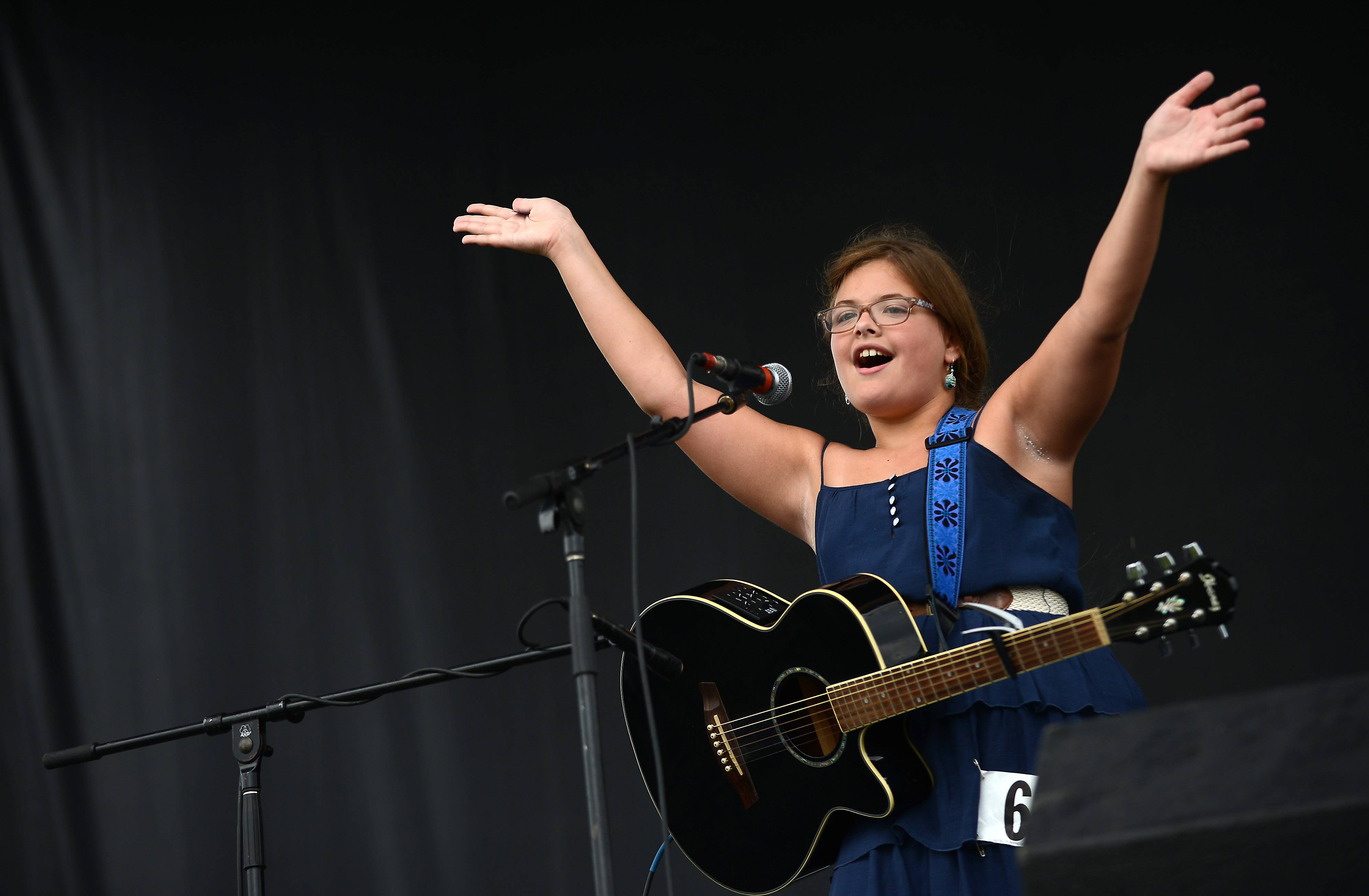 Livia LaMarca, 10, of Pingree Grove gets the audience to clap along as she performs in the talent contest during last year's Lake in the Hills Summer Sunset Festival.