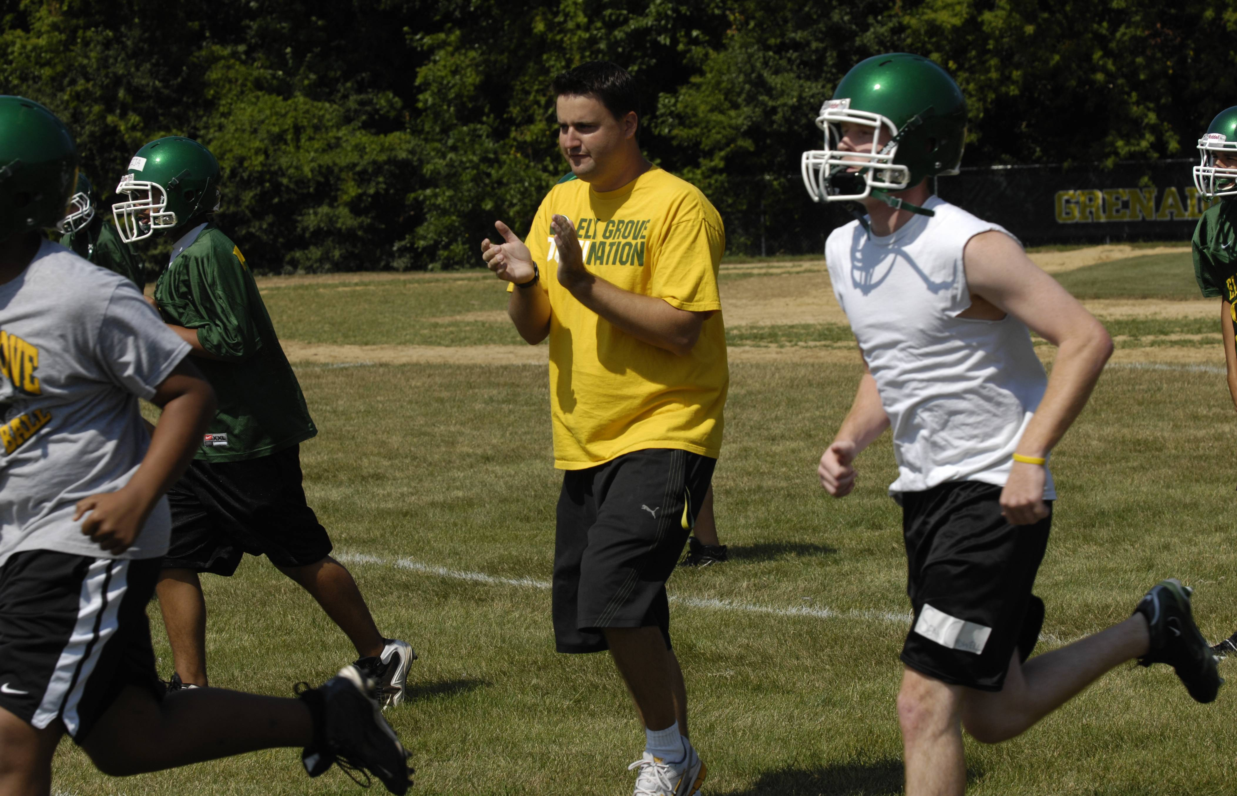Brian Doll, here directing Elk Grove in practice in 2009, is back on U.S. soil and directing New Trier's football program.
