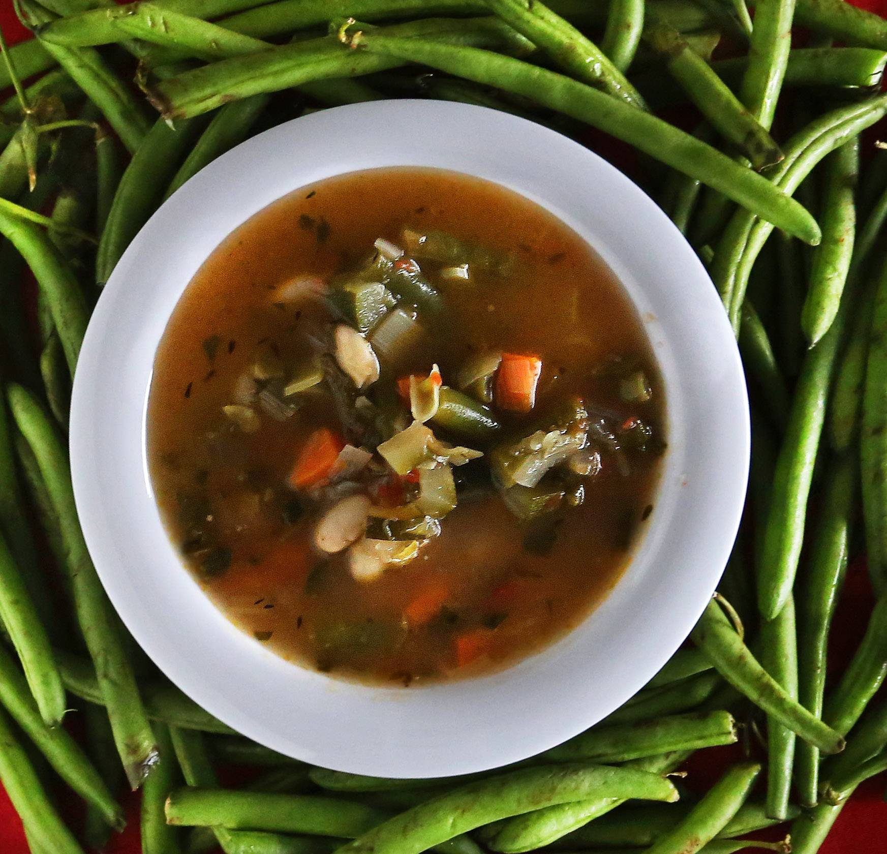 A bounty of summer vegetables swim together in a bowl of soup inspired by famed restaurateur Alice Waters.