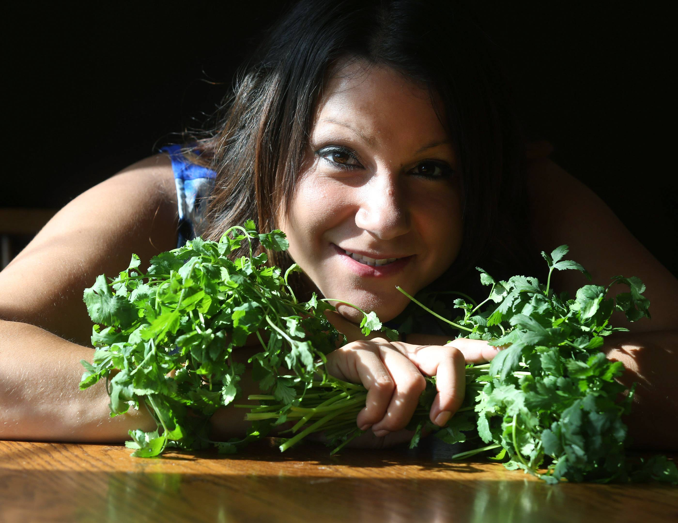 Jamie Andrade of Elk Grove Village grows cilantro; she says she loves the bright flavor it adds to recipes.