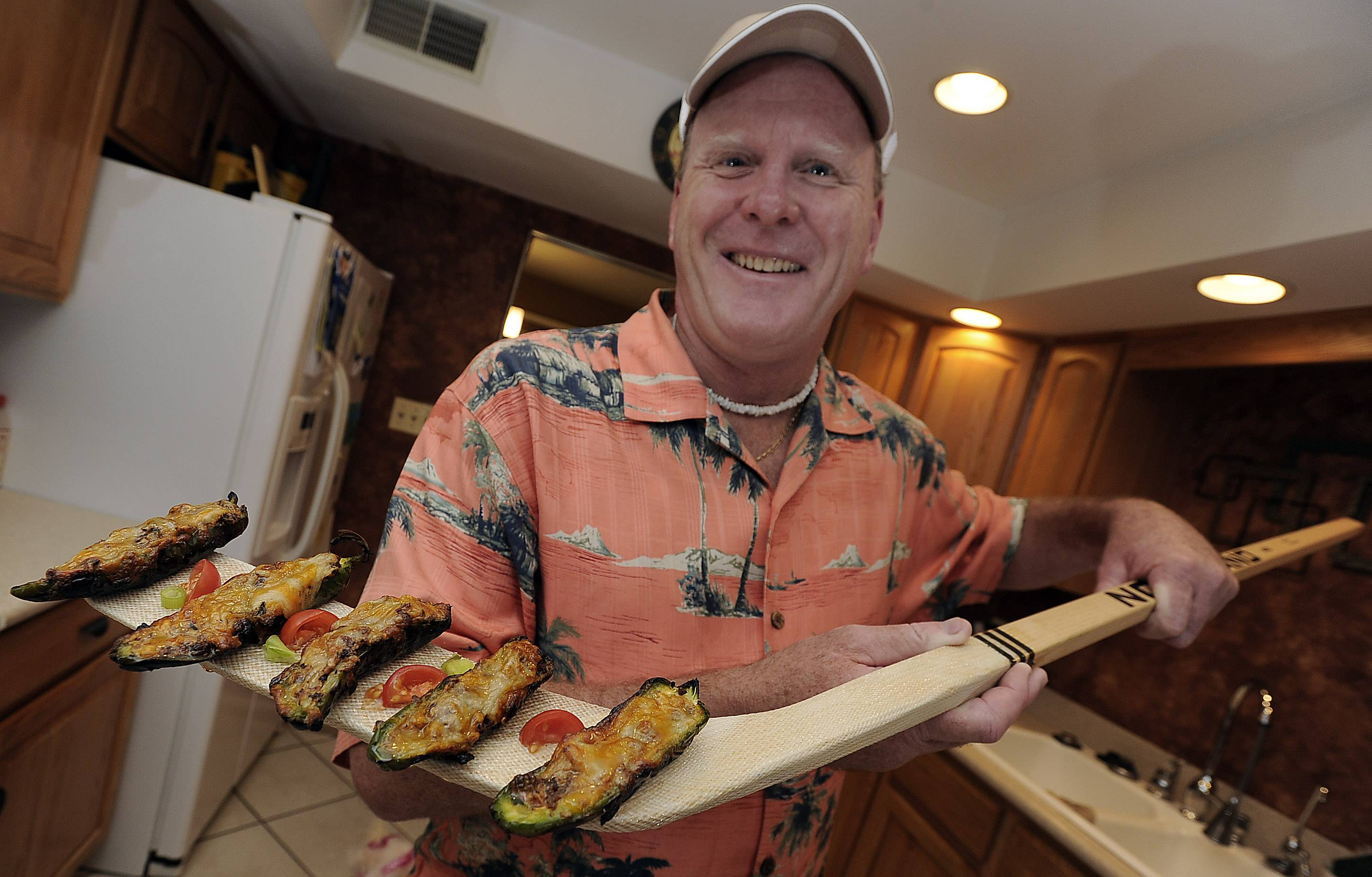 Jack Mac Intosh of Itasca serves up his famous Jalapeno Pirogues on hockey stick. When he's not cooking, Mac Intosh is a volunteer coach for youth sports.