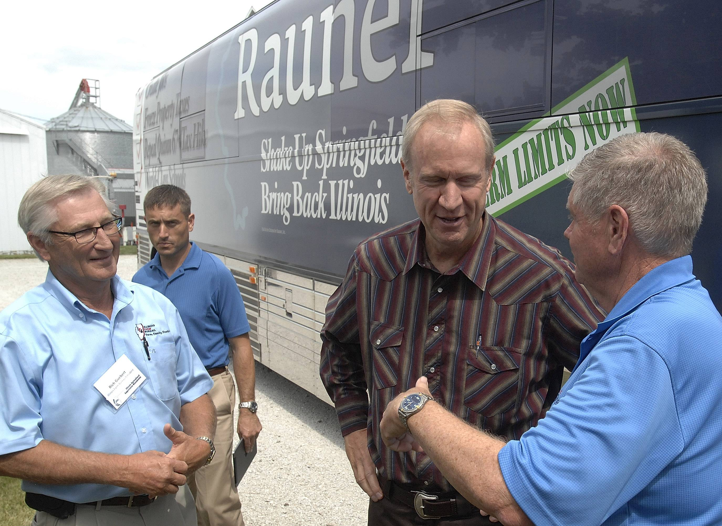 Gubernatorial candidate Bruce Rauner is greeted by state Sen. Jim Oberweis, right, candidate for the U.S. Senate, and Illinois Farm Bureau President Rich Guebert, left, as Rauner arrives Wednesday at the Illinois Agricultural Legislative Roundtable forum in Bloomington, Ill.